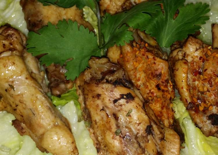 Step-by-Step Guide to Prepare Homemade Yummy chicken wings and drums on salad