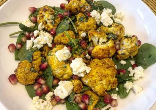 Turmeric roasted cauliflower salad with feta and zhoug style dressing