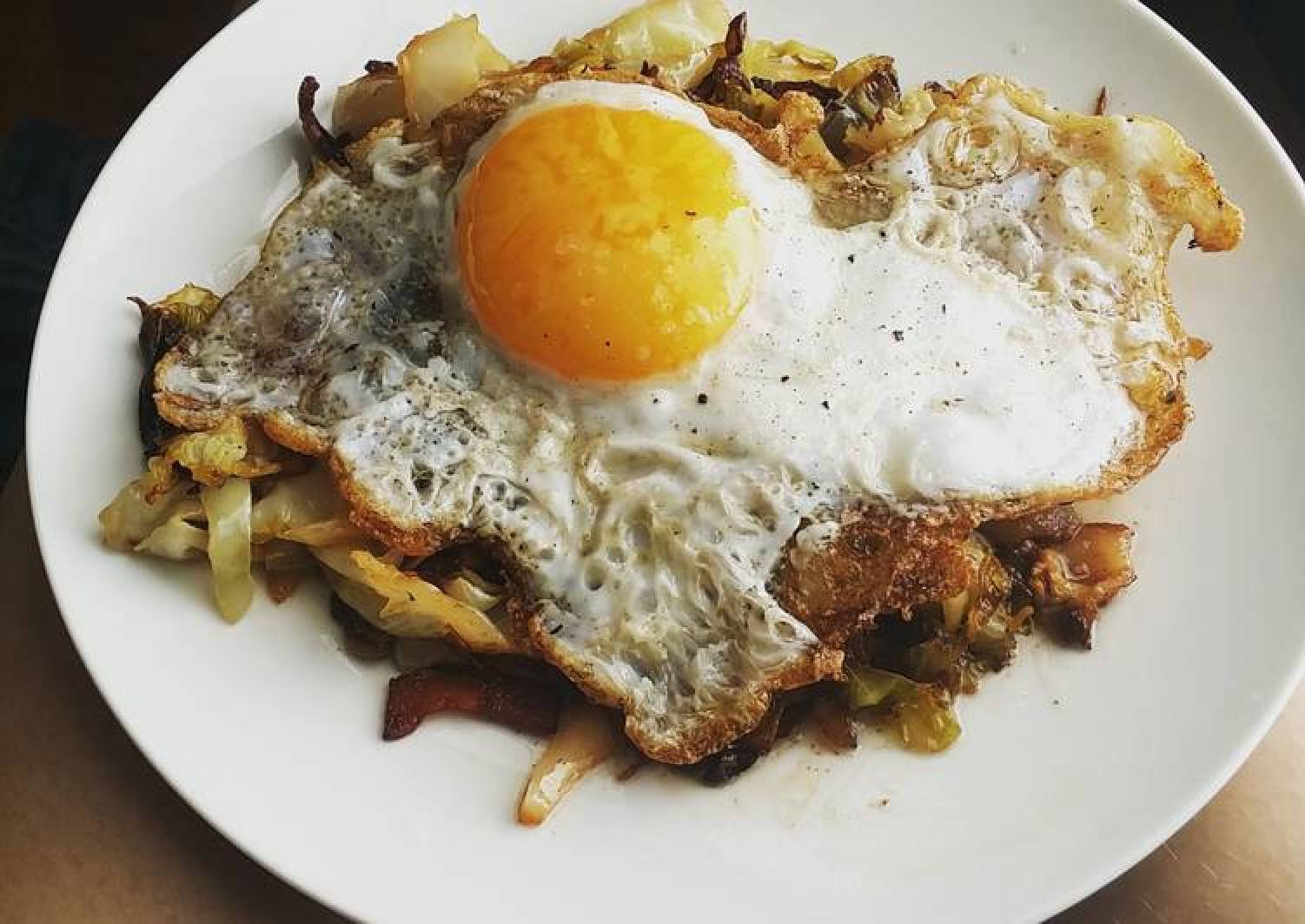 Egg topped southern fried cabbage