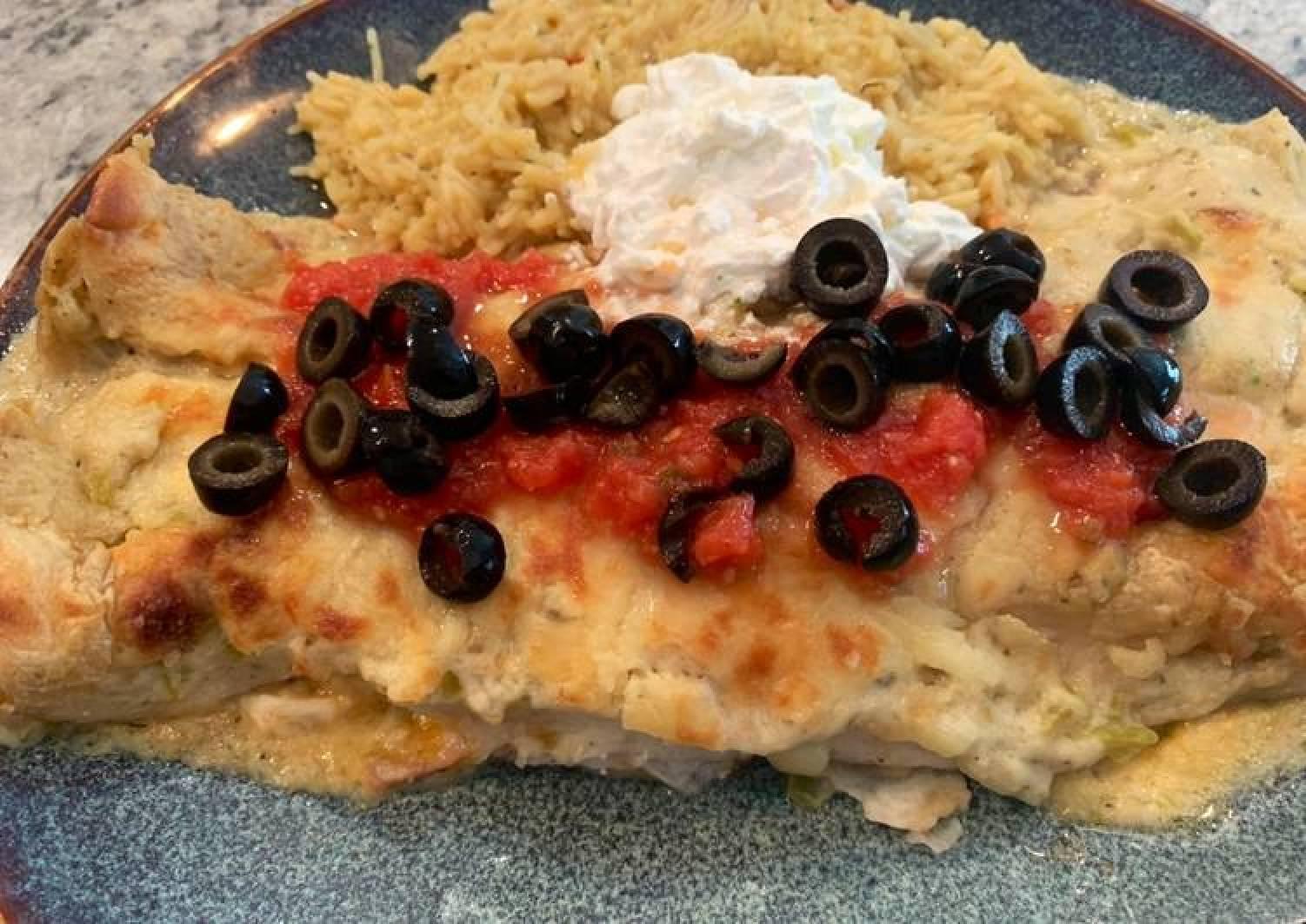 Chicken enchiladas with green chili cream sauce