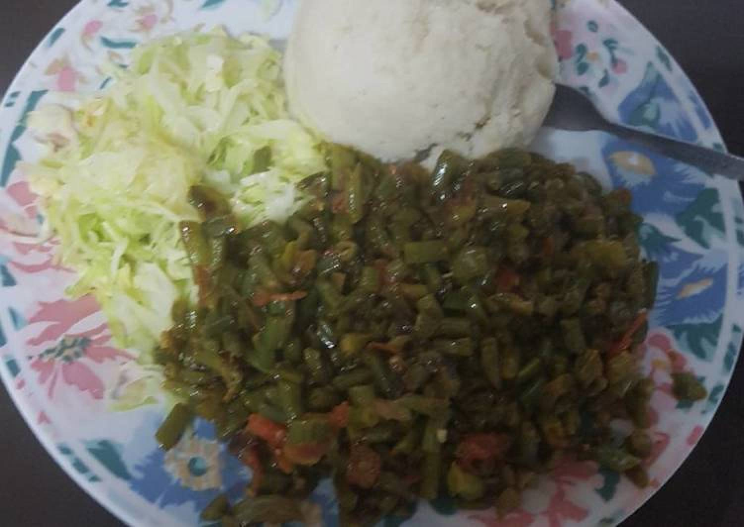 Ugali served with fried French beans and steamed cabbage