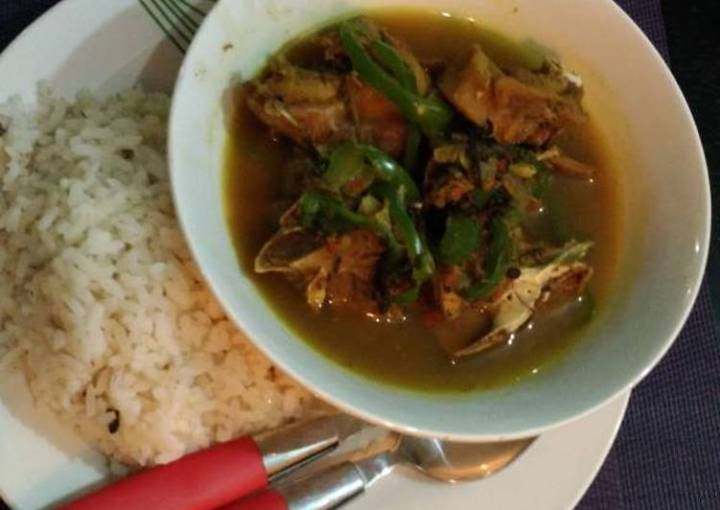 Ofada rice with chicken pepper soup