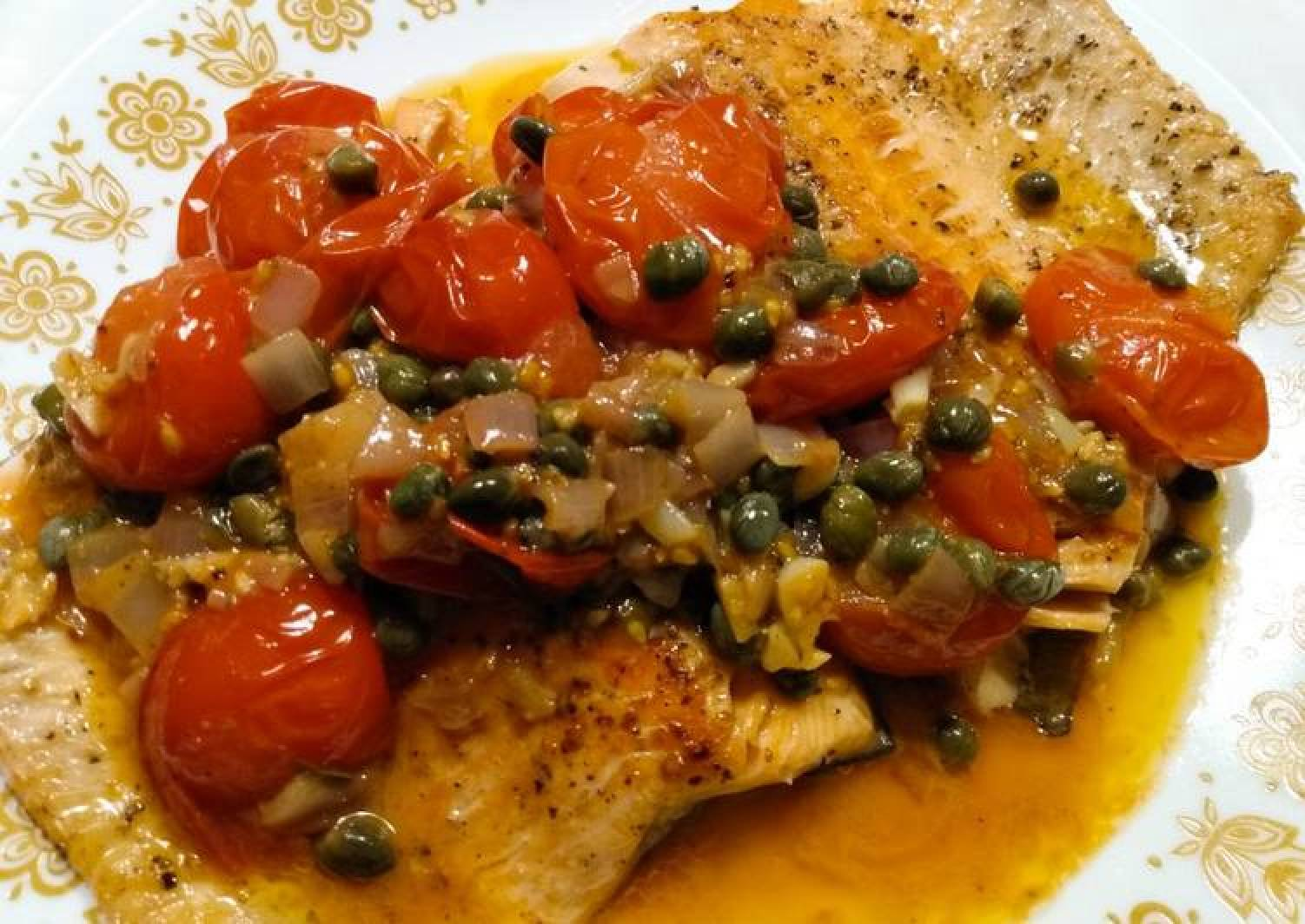Steelhead trout with spicy tomato and caper sauce