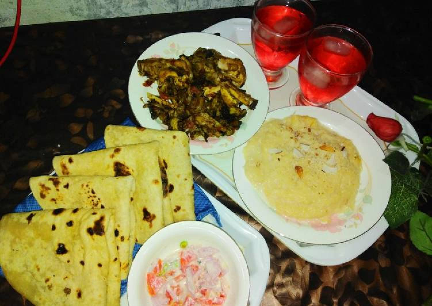 Chicken karaily and sheer khurma with rooti salad and drink