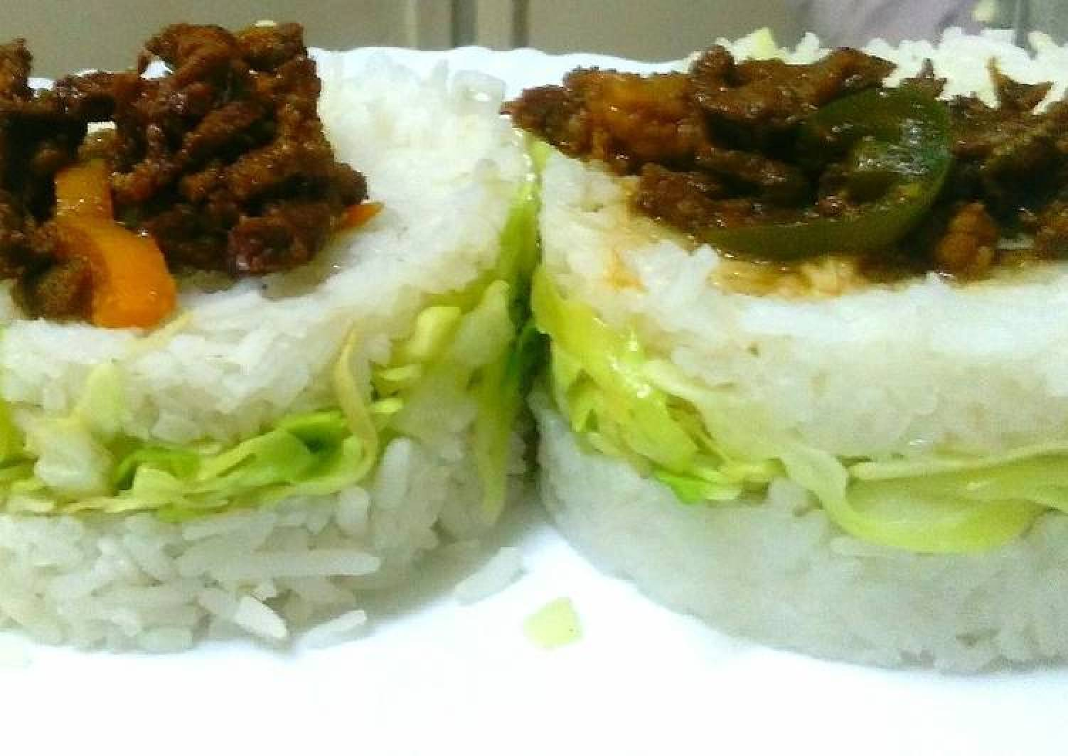Goat meat strips in cabbage rice sandwich