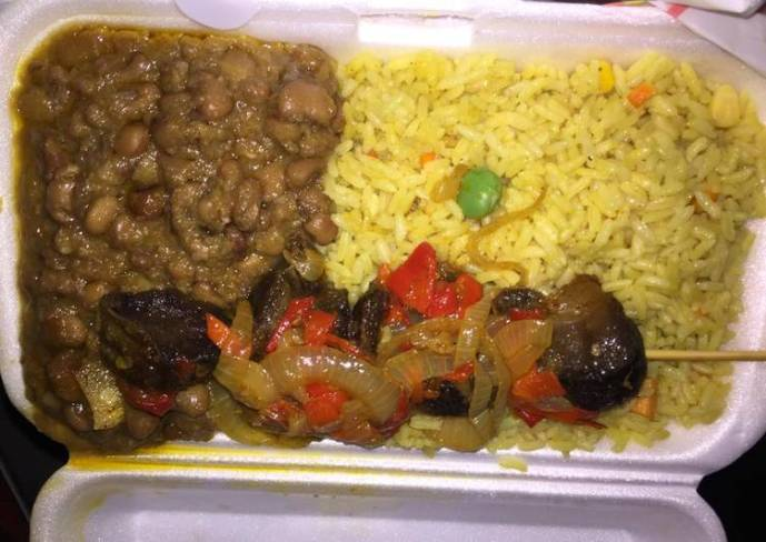 Fried rice and beans with beef kebab