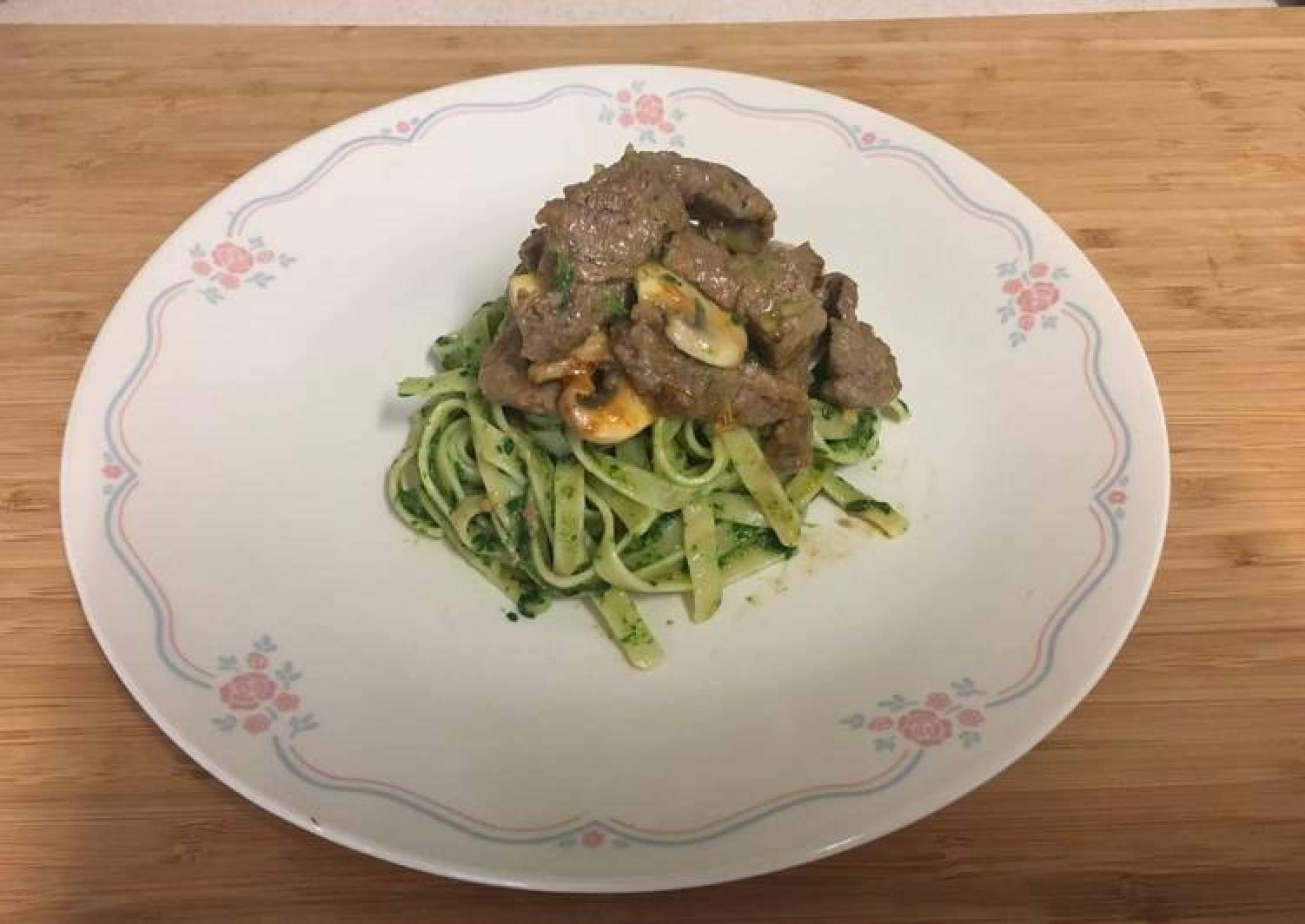 Beef,mushroom saute', spinack sauce and Fettuccine