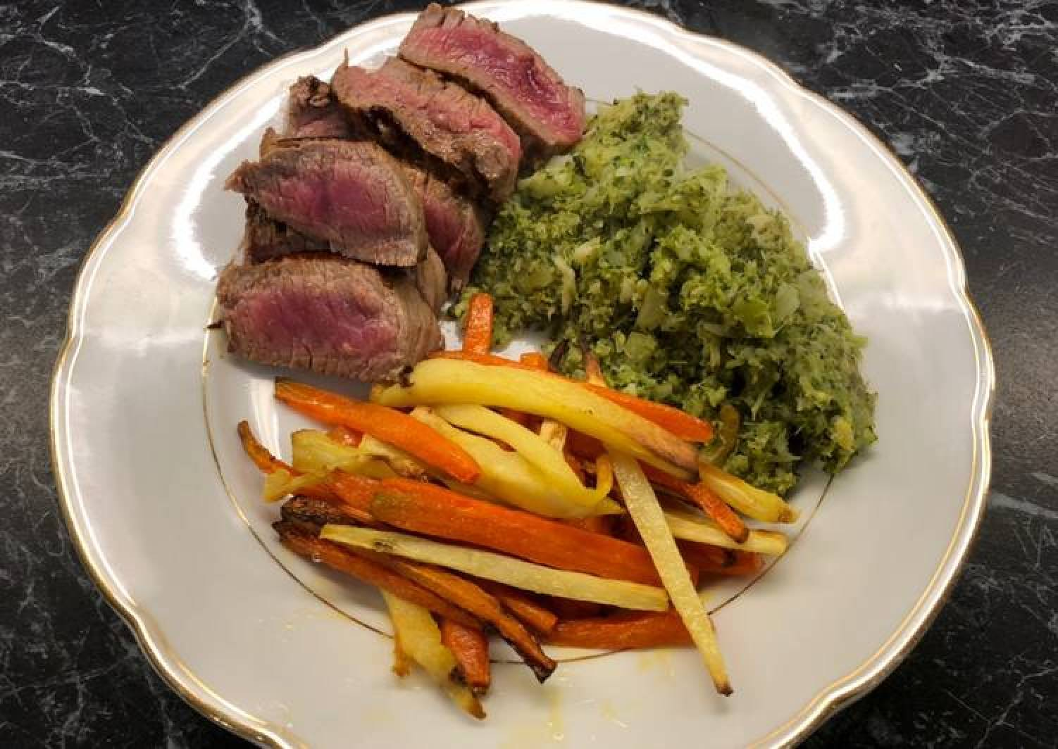 Steak with brocolli mash and parsnip/carrot fries