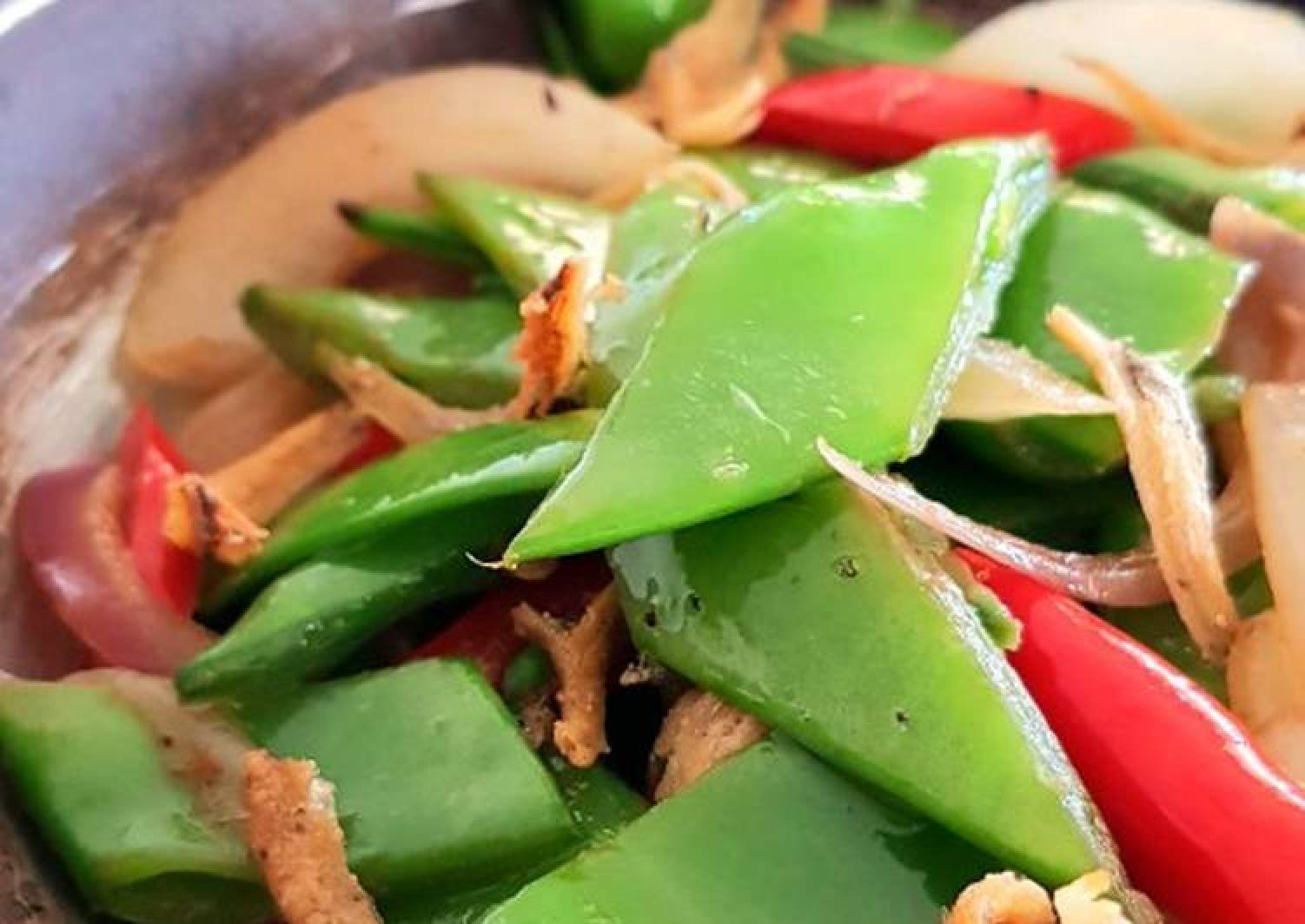 Snow Peas with Caramelized Onions and Crispy Anchovies