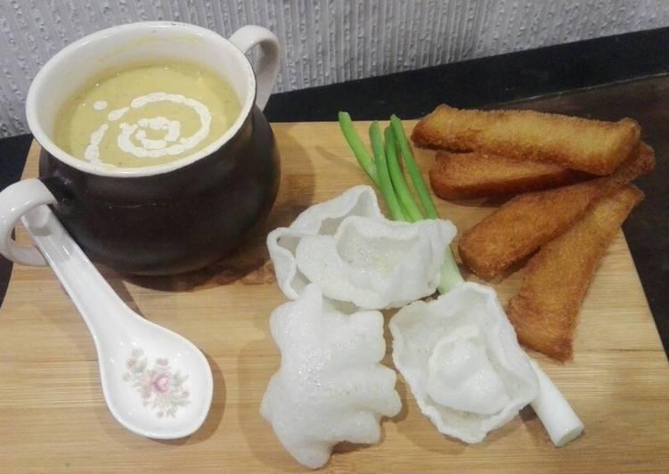Malligawtani soup with fried garlic bread