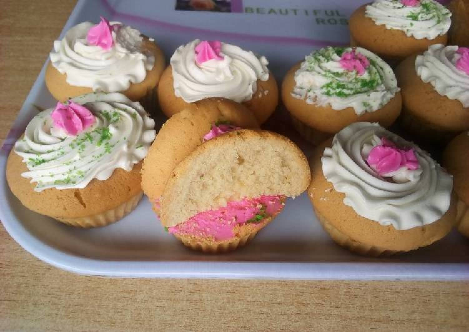 Vanilla cupcakes with cream frosting