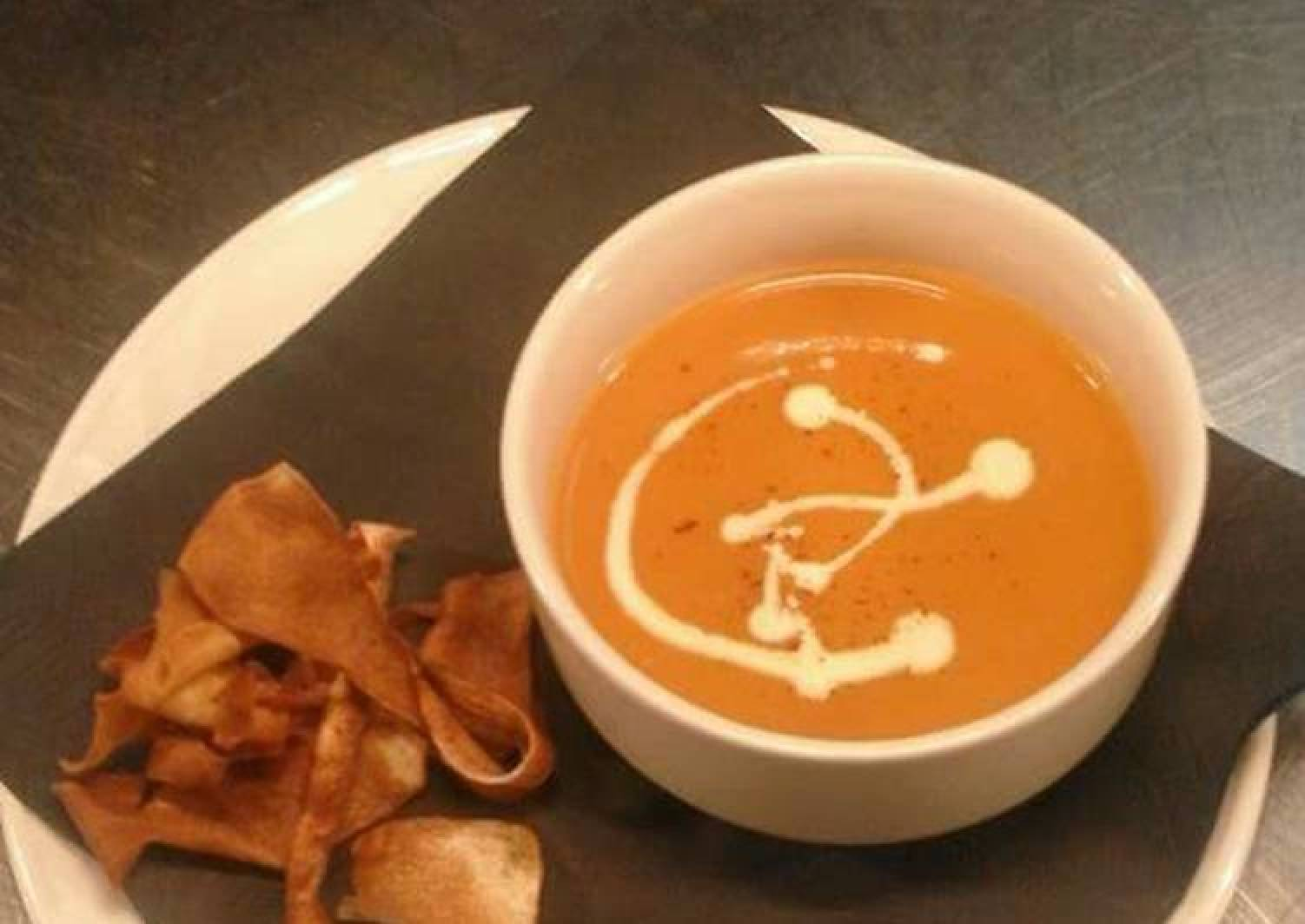 Cream of tomato soup with parsnip crisps