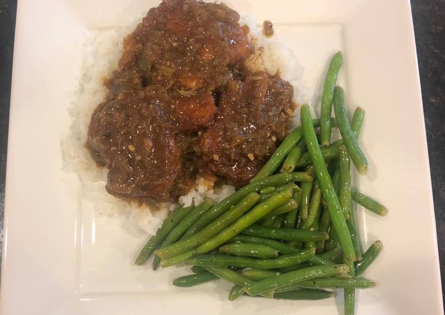 Smothered chicken or pork chops (shown with pork chops)
