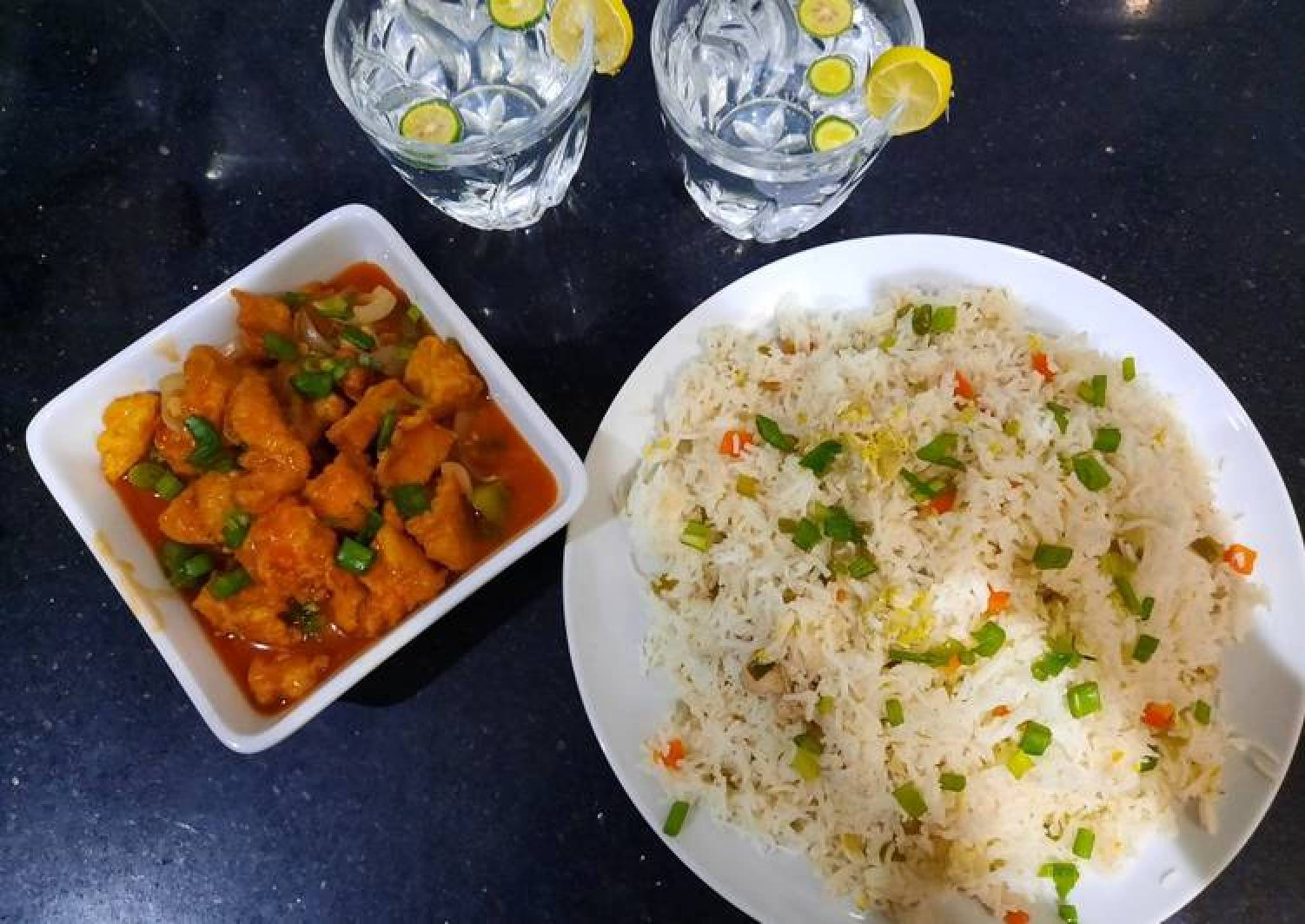 Chicken manchurian and egg vegetable fried rice with fresh lime