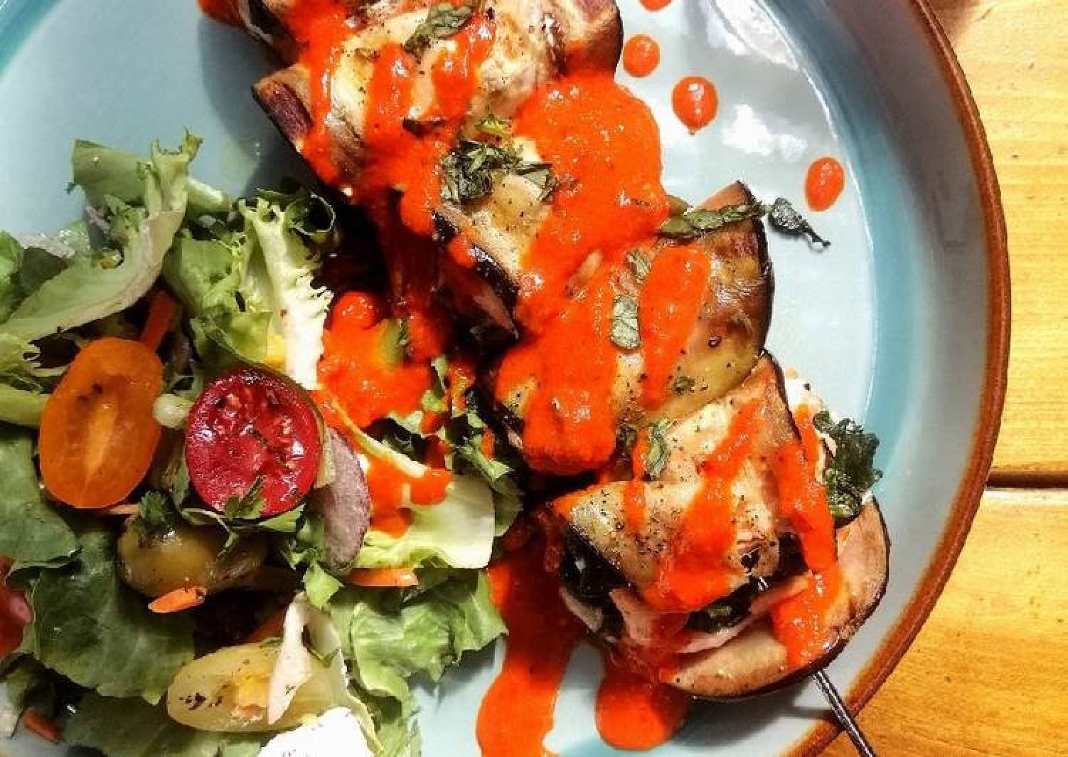 Salmon,aubergine and spinach skewers with red pepper dressing