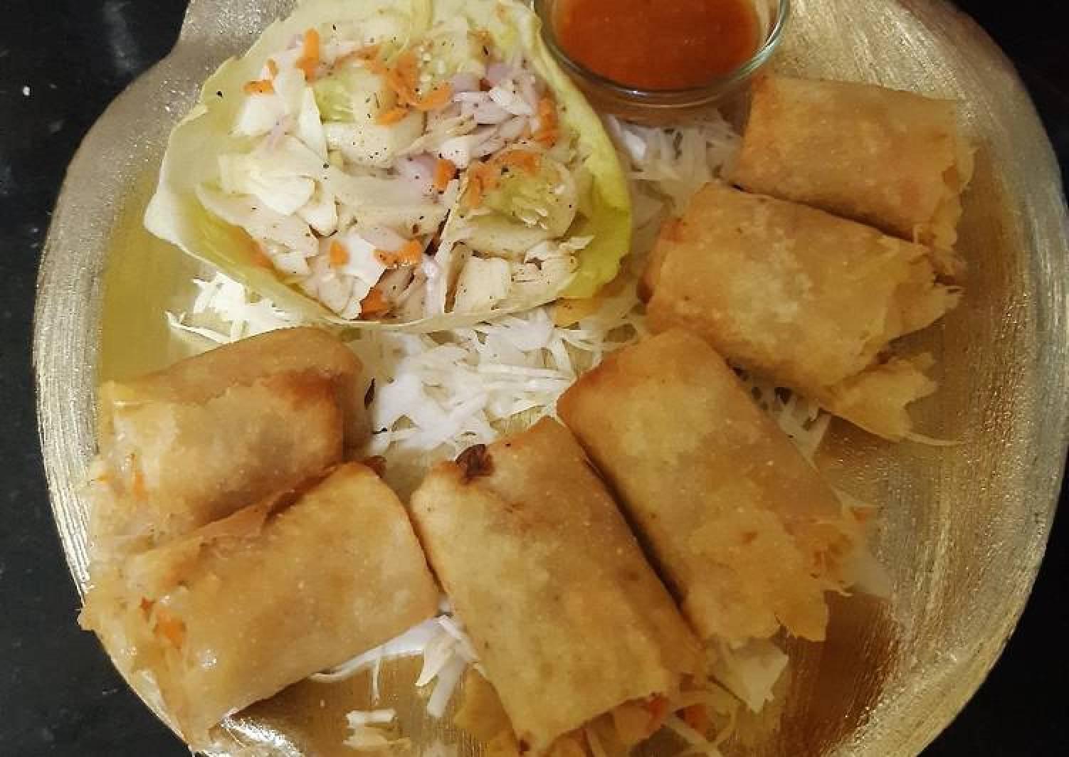 Spring rolls with kimchi salad and schezwan sauce dip