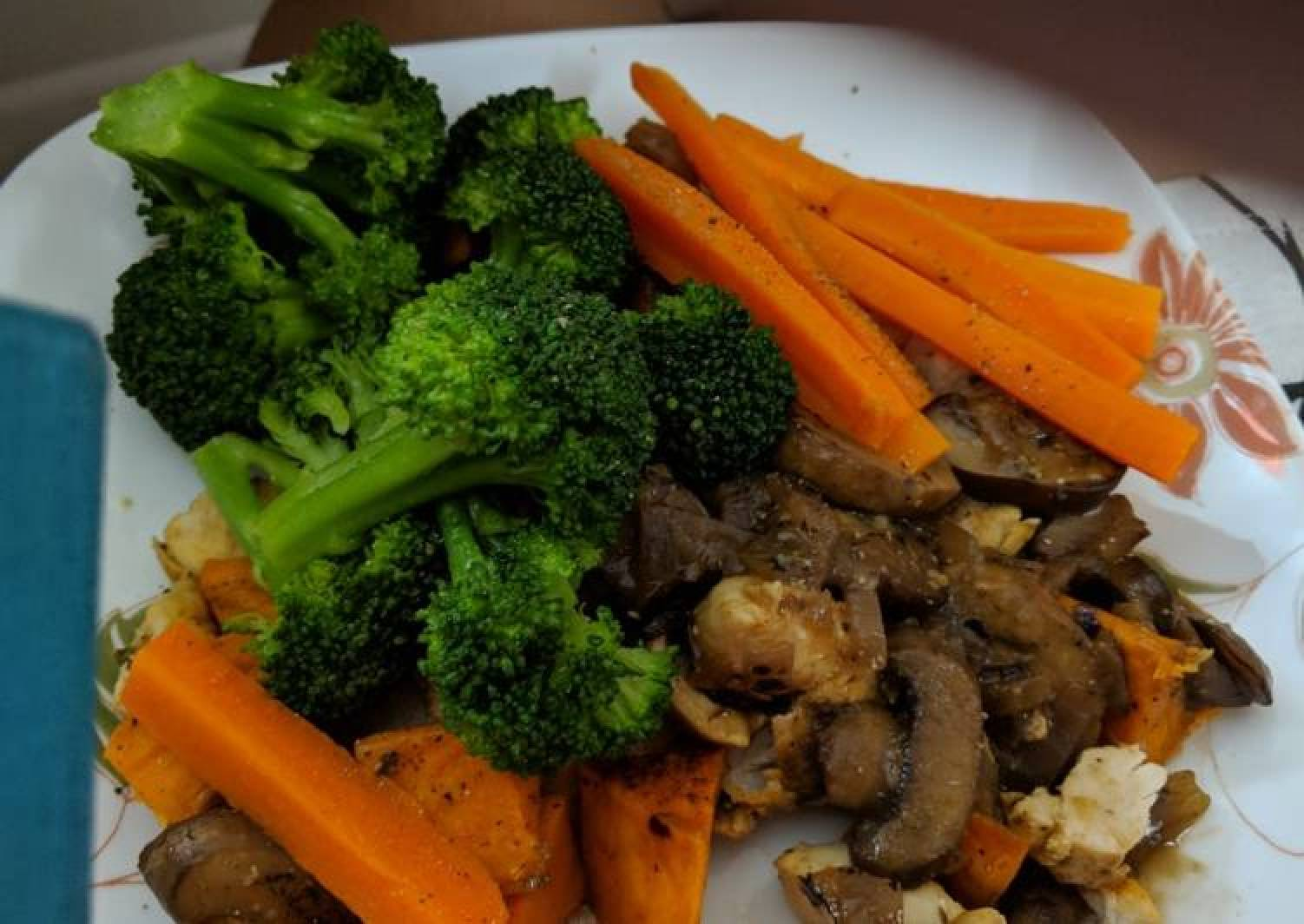 Steamed carrots broccoli over baked chicken in mushroom sauce