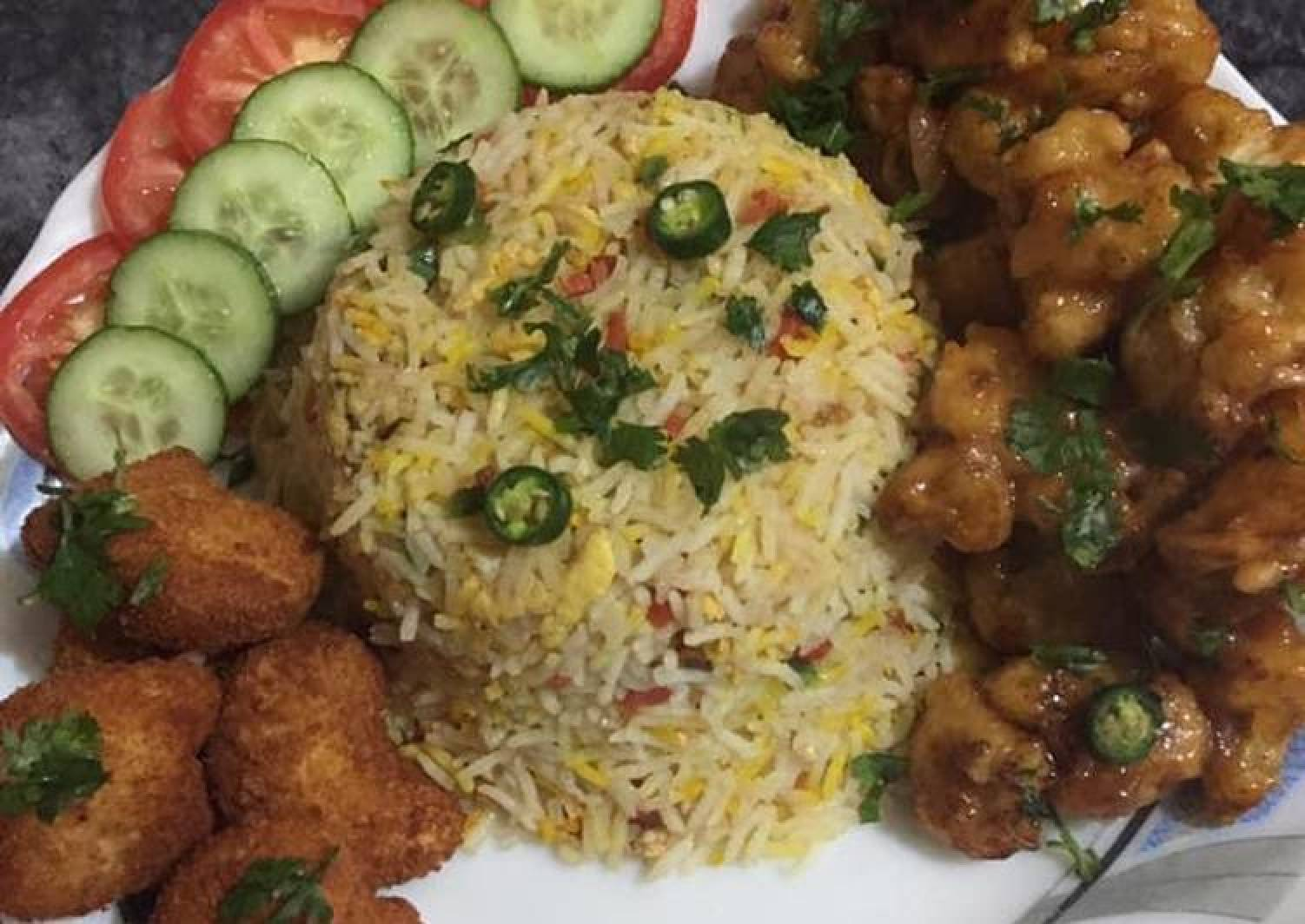 Gobi manchurian with vegetables rice and chicken nuggets