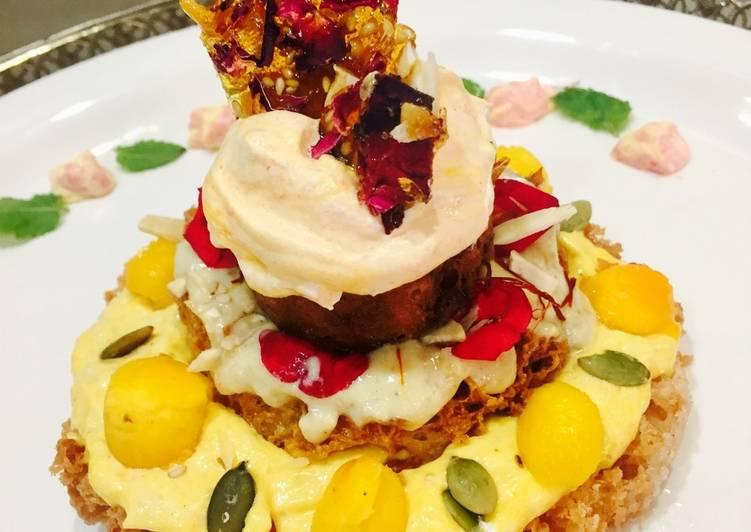 Ghewar cake with gulkand and mango rabdi mousse