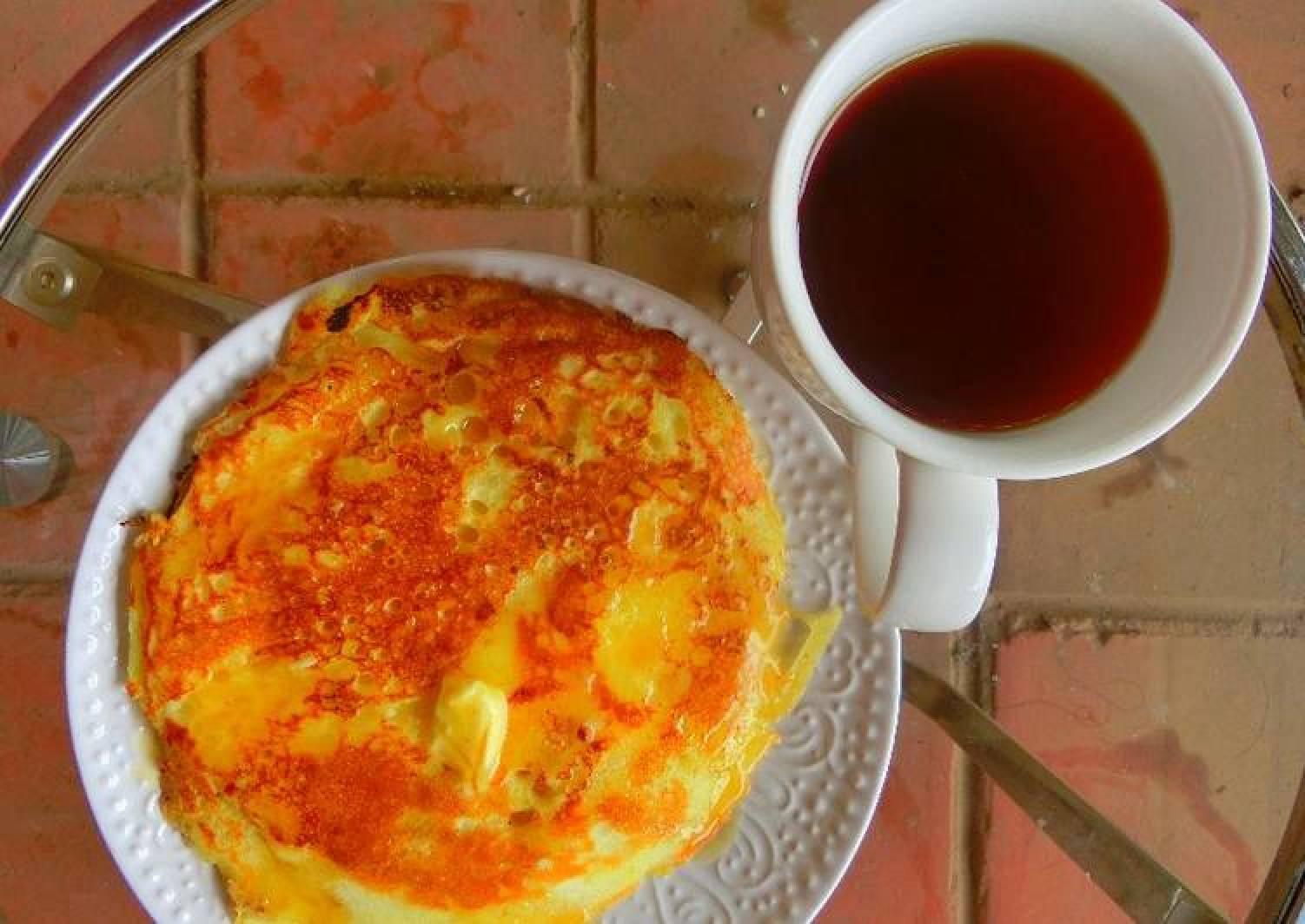 Pancake, butter and hot tea