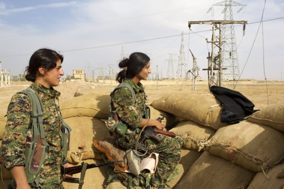 Two female Kurdish soldiers of the Women's Protection Units (YPJ) on the front line against the Islamic State in Hassage, northeastern Syria (date unknown).