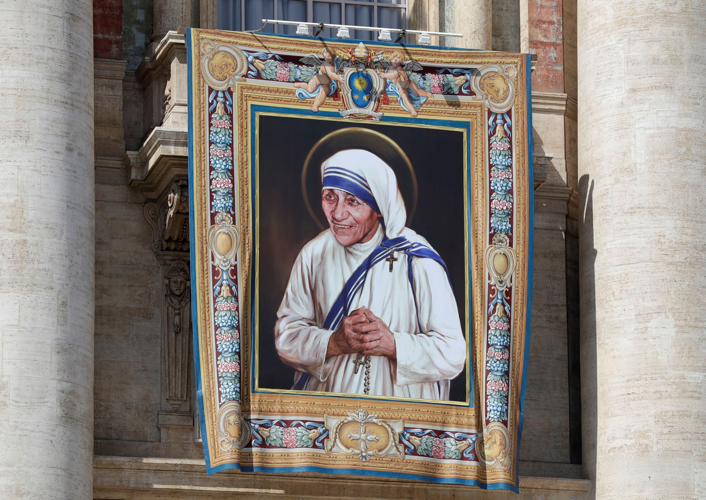 FILE - In this Thursday, Sept. 1, 2016 file photo, a tapestry showing Mother Teresa hangs from the central balcony of St. Peter's Basilica, in St. Peter's Square, at the Vatican.