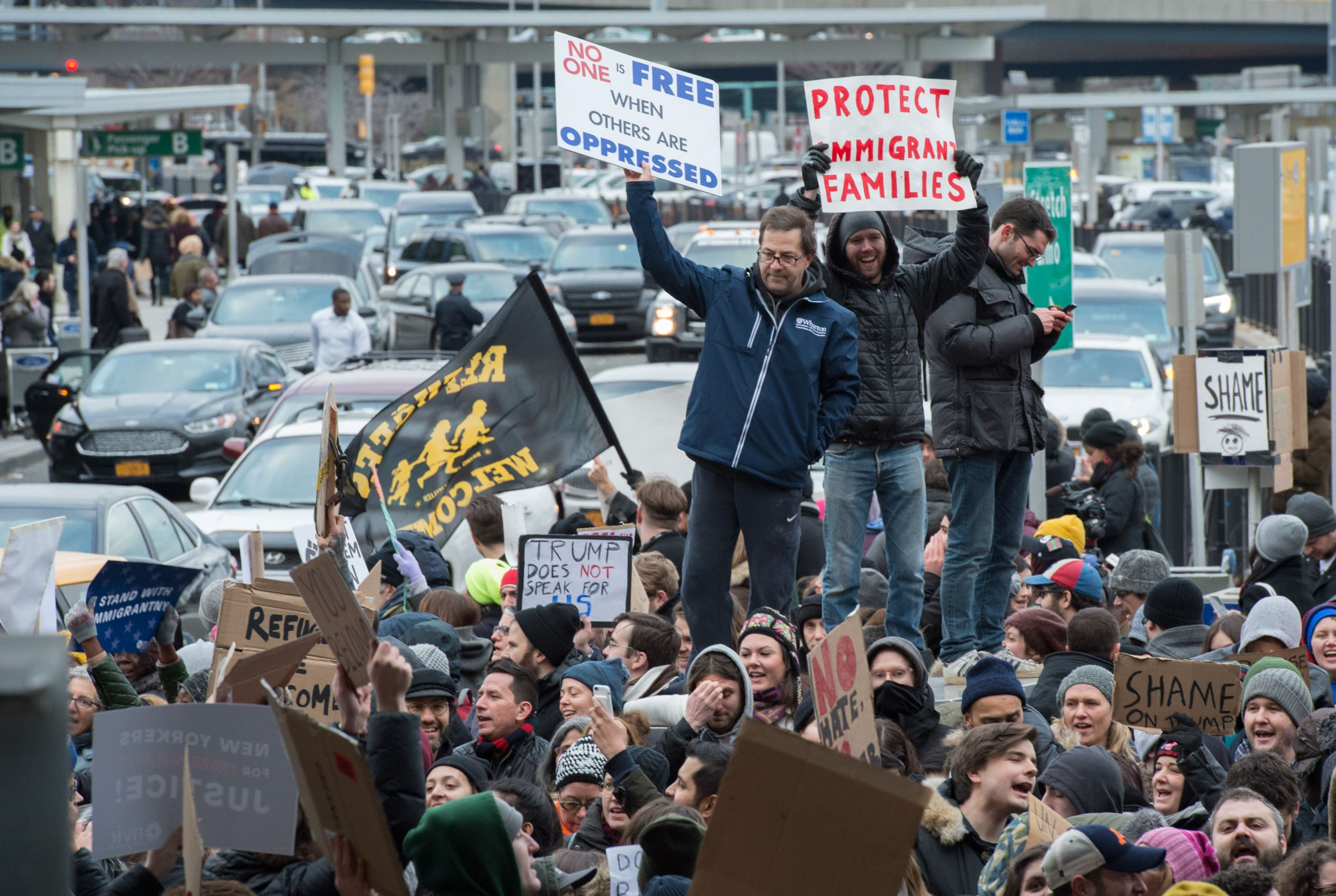 Protesters gather at JFK International Airport's Terminal 4 to demonstrate against President Donald Trump's executive order on January 28, 2017, in New York. Trump has signed a sweeping executive order to suspend refugee arrivals and impose tough controls on travellers from Iran, Iraq, Libya, Somalia, Sudan, Syria and Yemen.