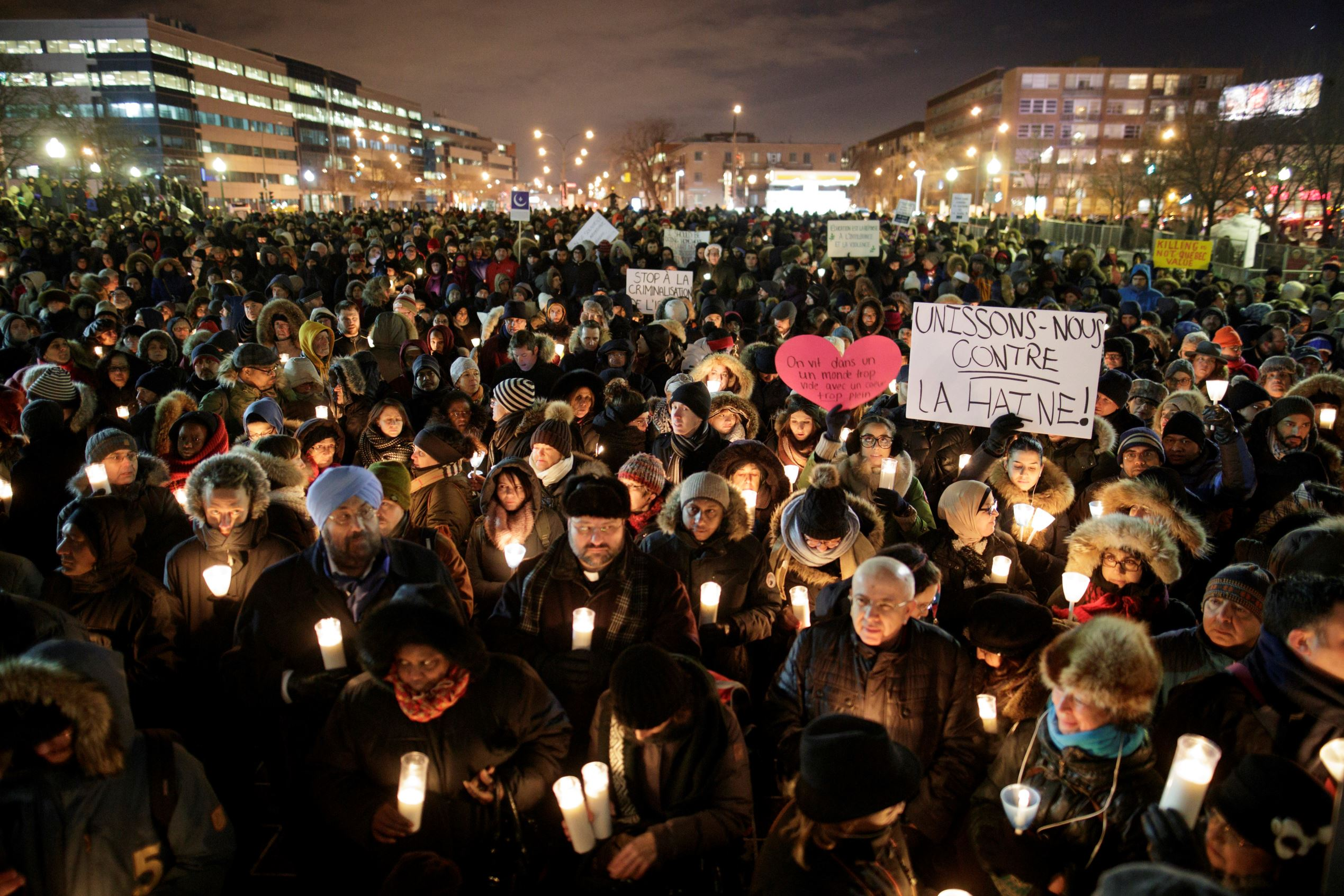People attend a vigil in support of the Muslim community in Montreal
