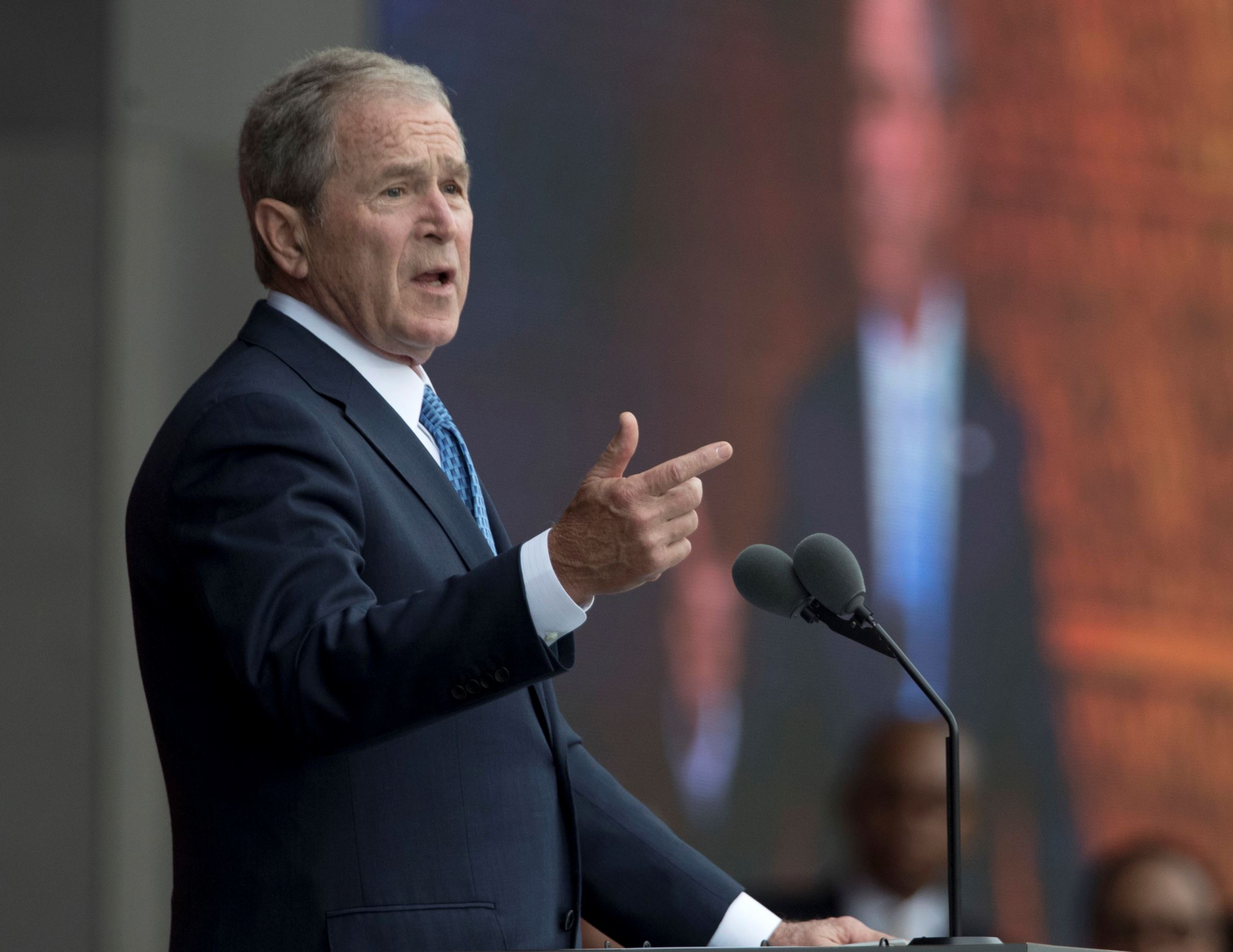 "In this Sept. 24, 2016 file photo, former President George W. Bush speaks in Washington. Bush said Monday, Feb. 27, 2017, ""we all need answers"" on the extent of contact between President Donald Trump's team and the Russian government, and he defended the media's role in keeping world leaders in check."