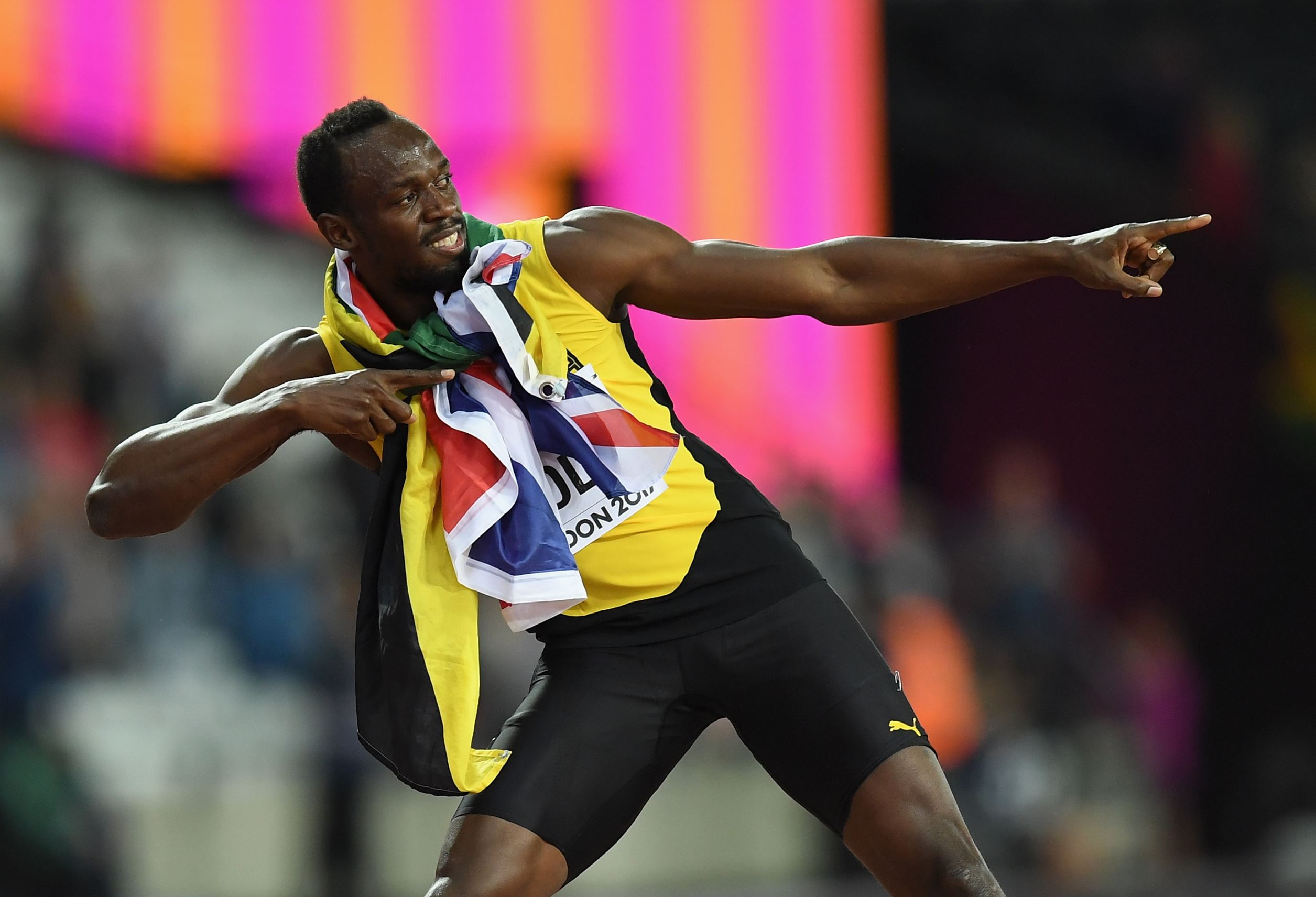 Slide 1 of 18: Usain Bolt of Jamaica celebrates during a lap of honour following finishing in third place in the mens 100m final during day two of the 16th IAAF World Athletics Championships London 2017.
