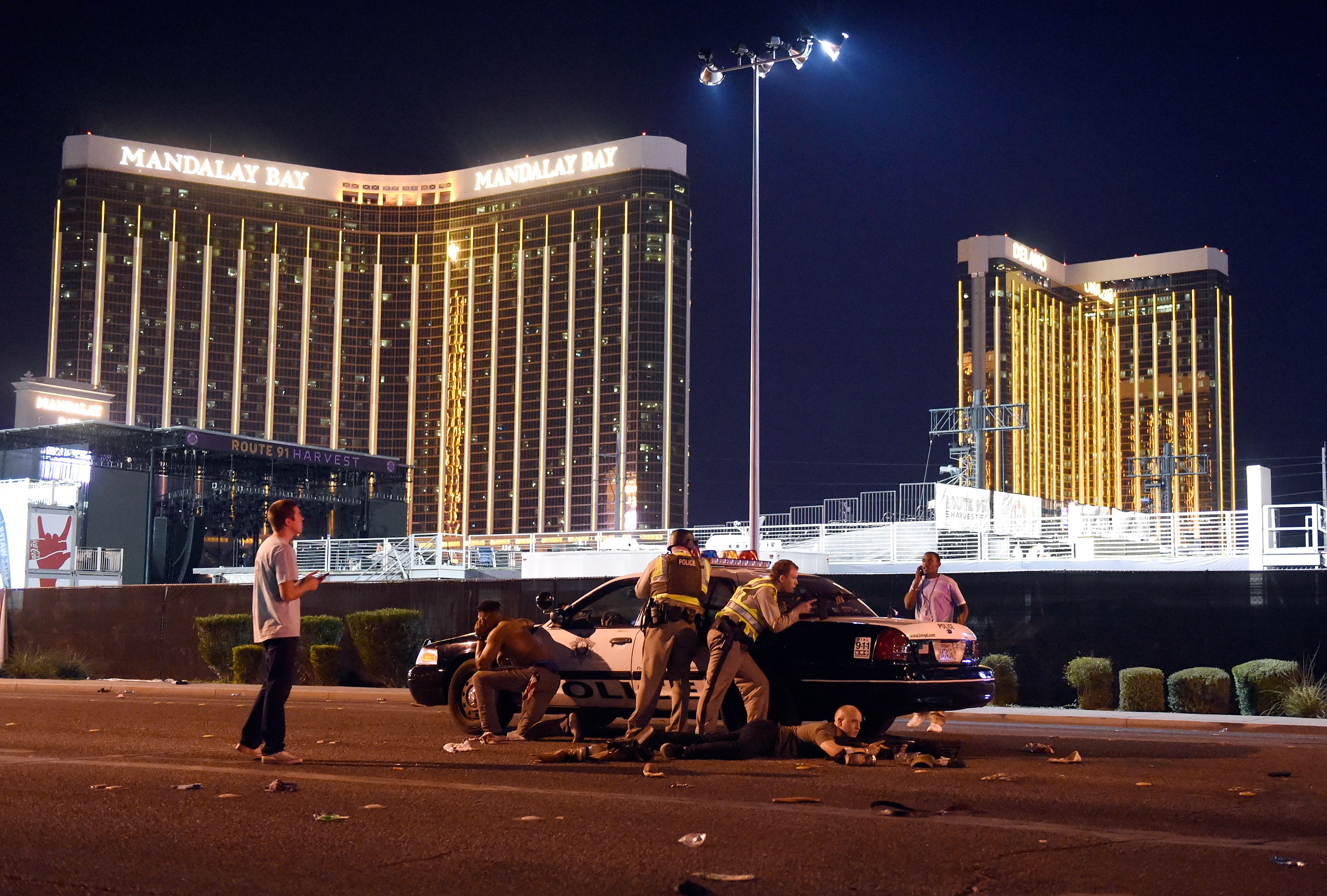 Las Vegas police stand guard along the streets outside the Route 91 Harvest Country music festival grounds of the Route 91 Harvest on October 1, 2017 in Las Vegas, Nevada.