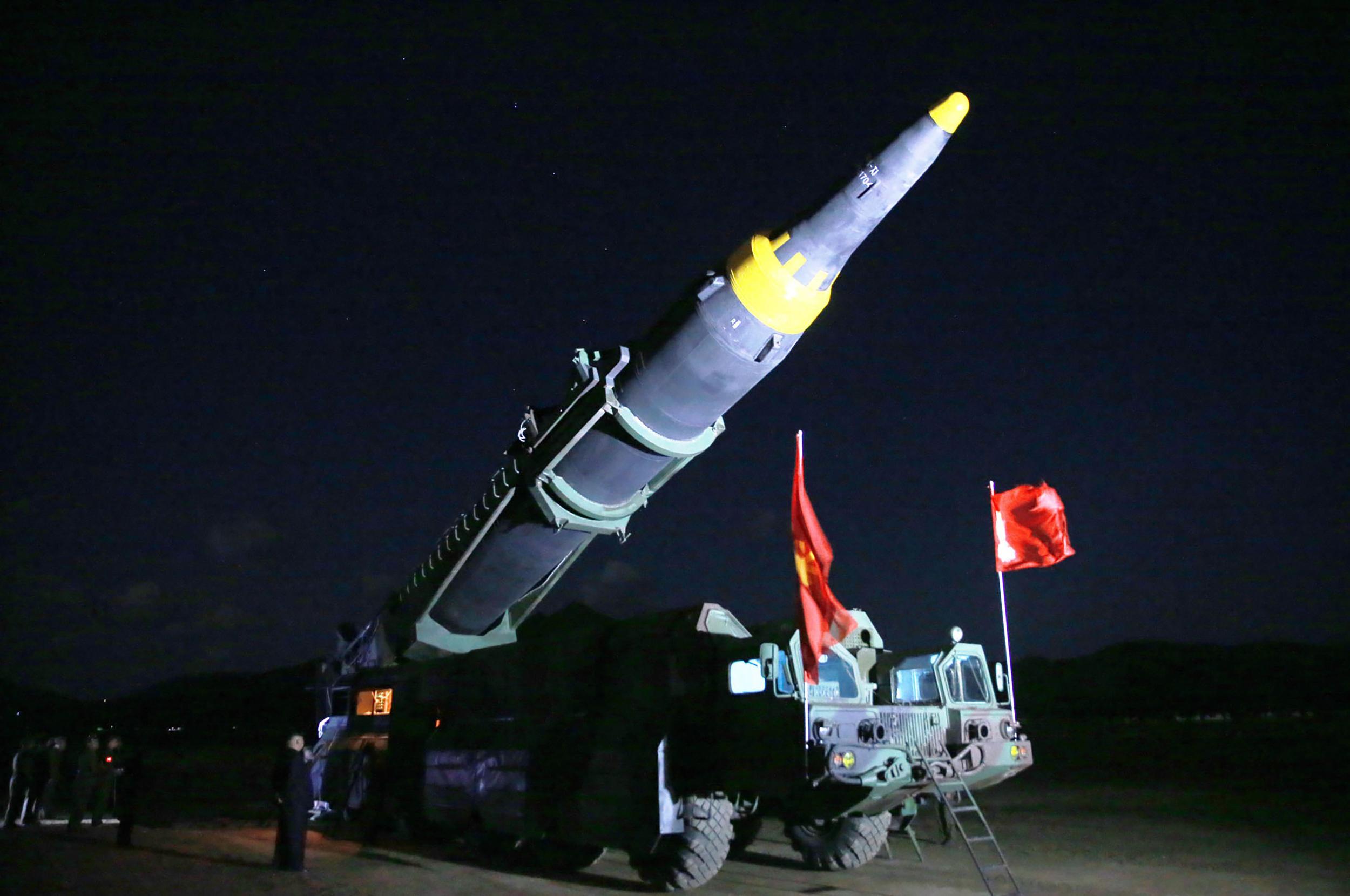 Kim Jong-un inspects a rocket.