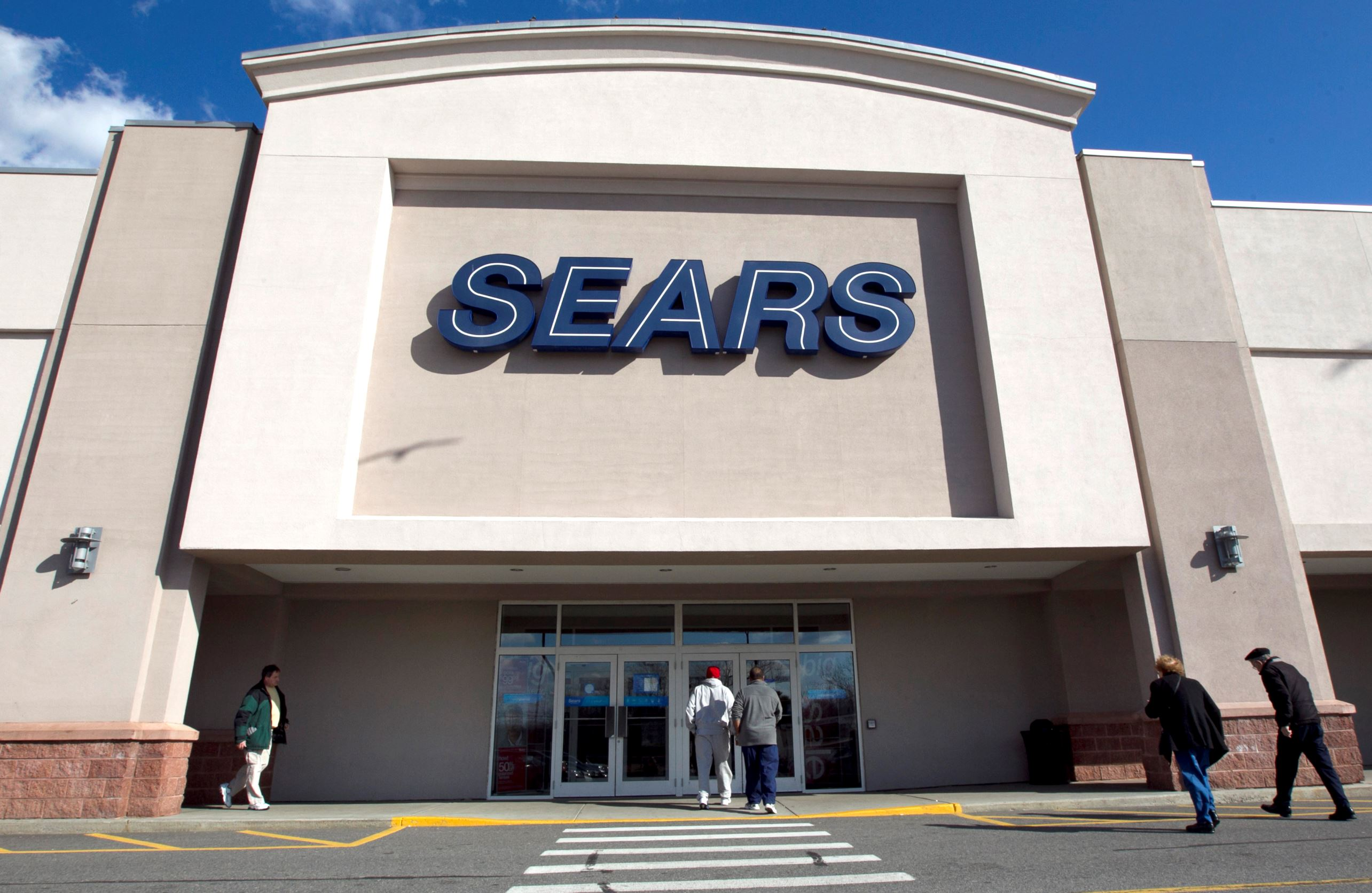 FILE - In this Feb. 22, 2012 file photo, shoppers enter a Sears department store location in Dedham, Mass. Sears Holdings Corp. reports quarterly financial results before the market opens on Thursday, Dec. 4, 2014. (AP Photo/Steven Senne, File)