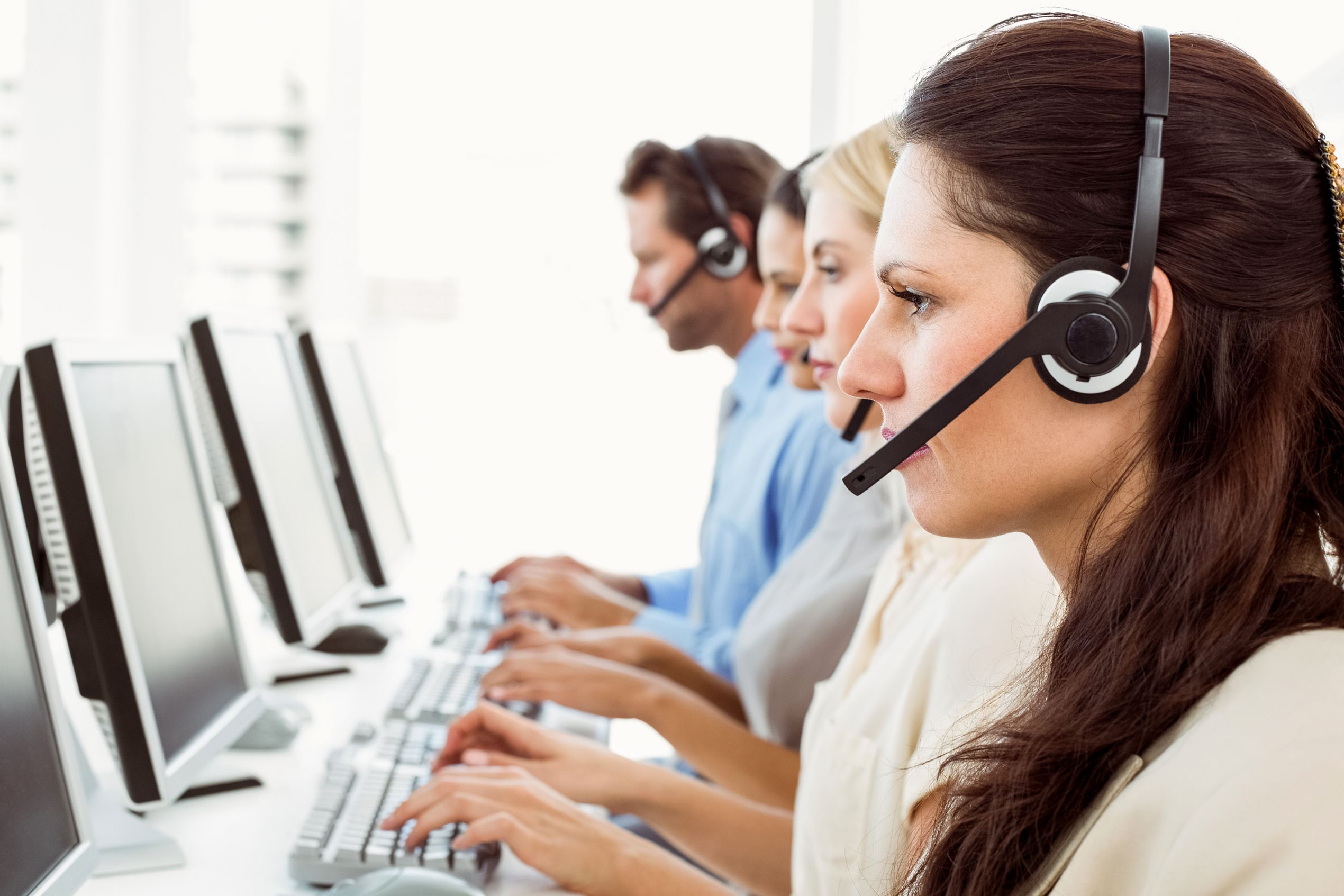 Customer Service representatives on the phone. Getty Images/iStockphoto
