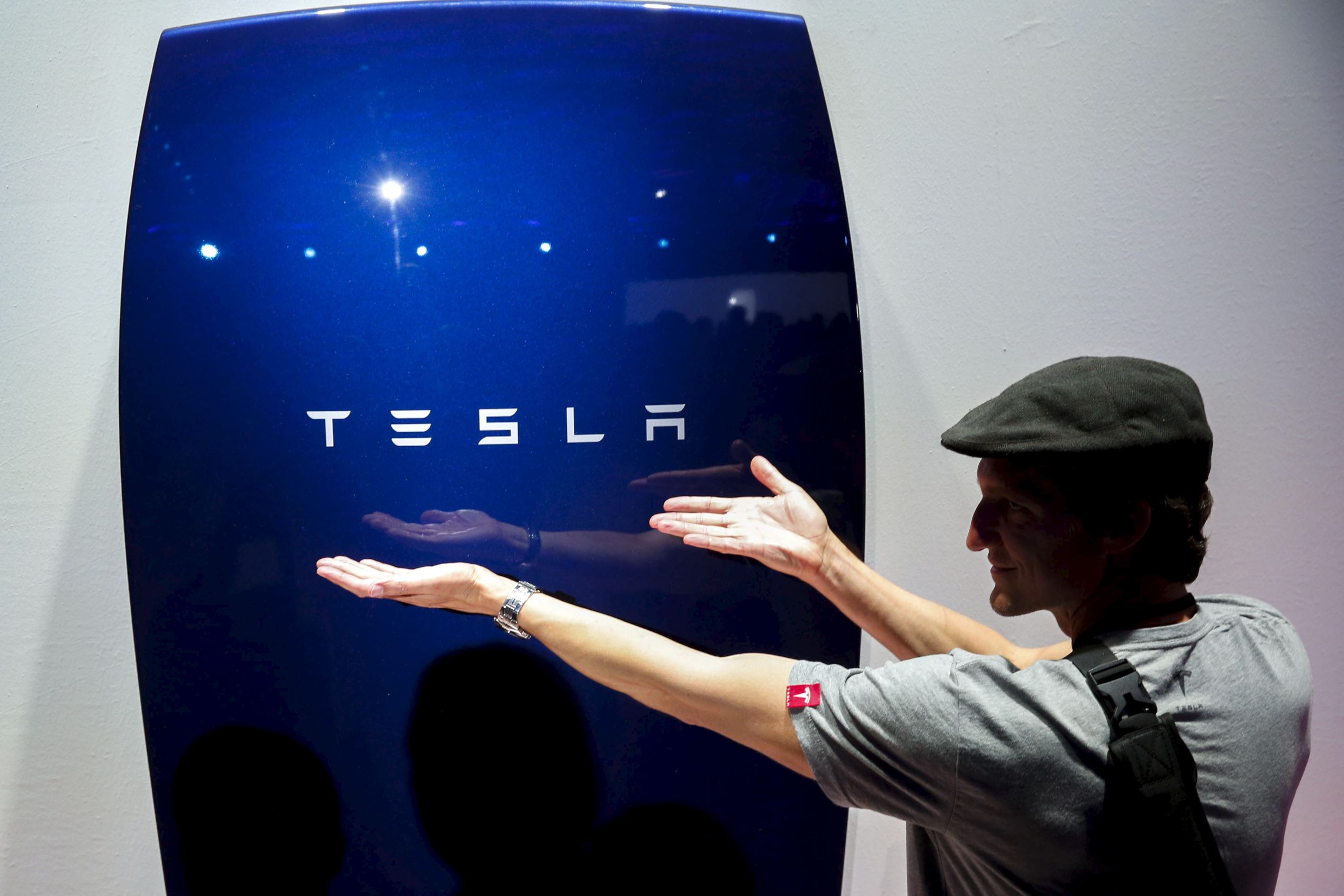 Attendees take pictures of the new Tesla Energy Powerwall Home Battery during an event at Tesla Motors in Hawthorne, Calif.