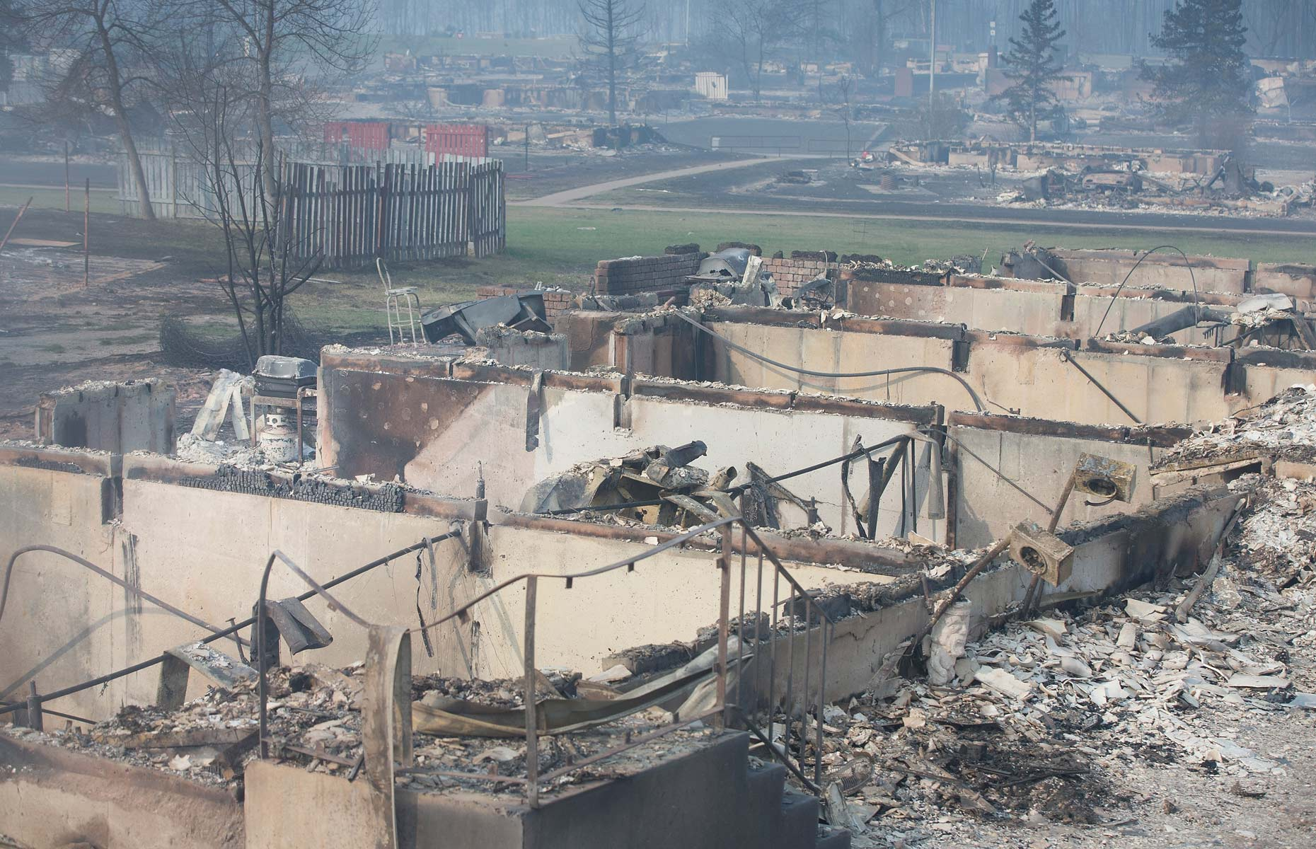 Home foundations are all that remain in a residential neighborhood destroyed by a wildfire on May 6, 2016 in Fort McMurray, Alta.