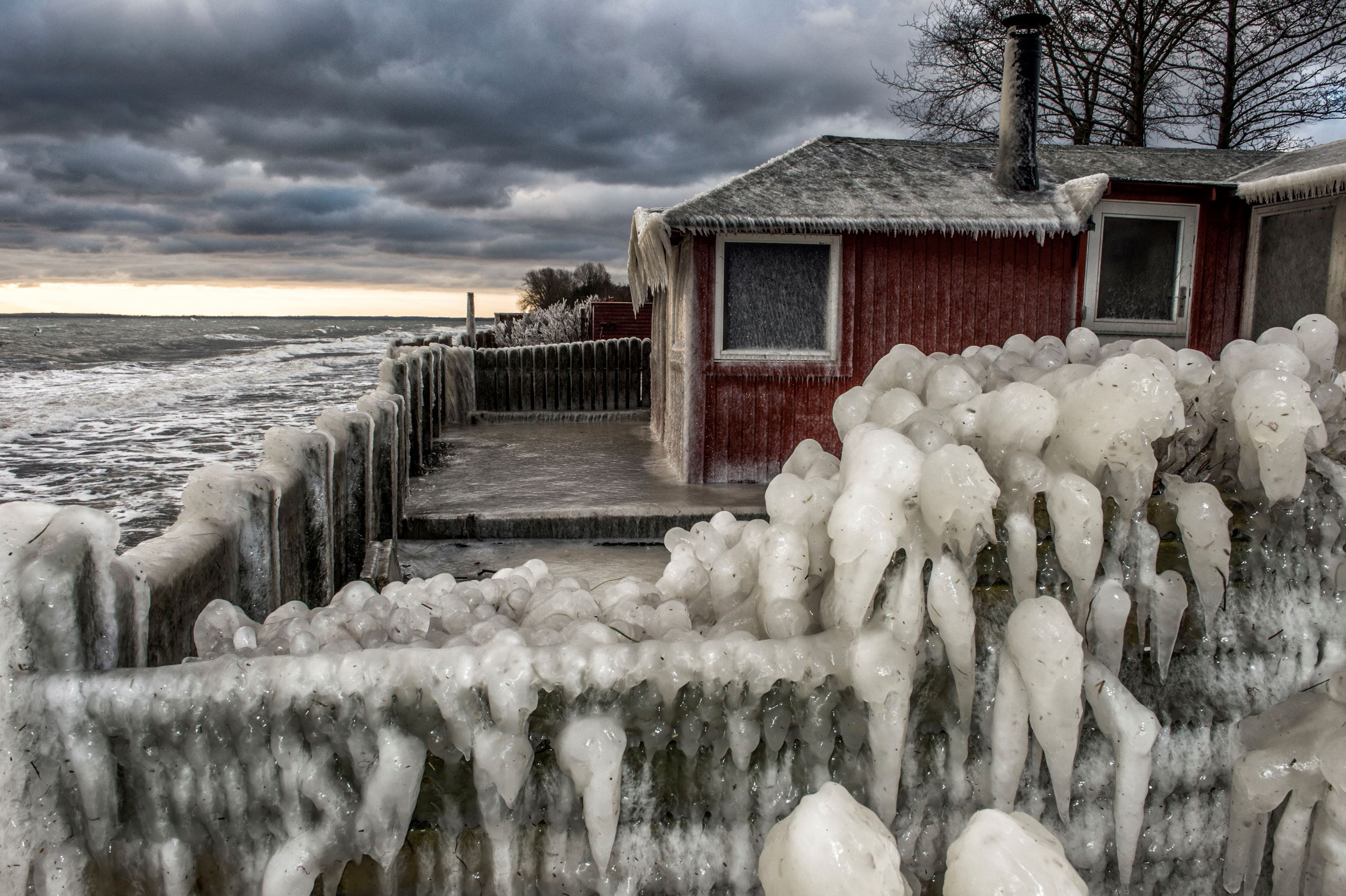Слайд 3 из 86: Ice formations are seen at the beach near Fakse Ladeplads, south of Copenhagen, Denmark, Tuesday Jan. 5. 2016. Daytime temperatures in the area were between zero and minus four degrees Celcius. (Per Rasmussen/Polfoto via AP) DENMARK OUT