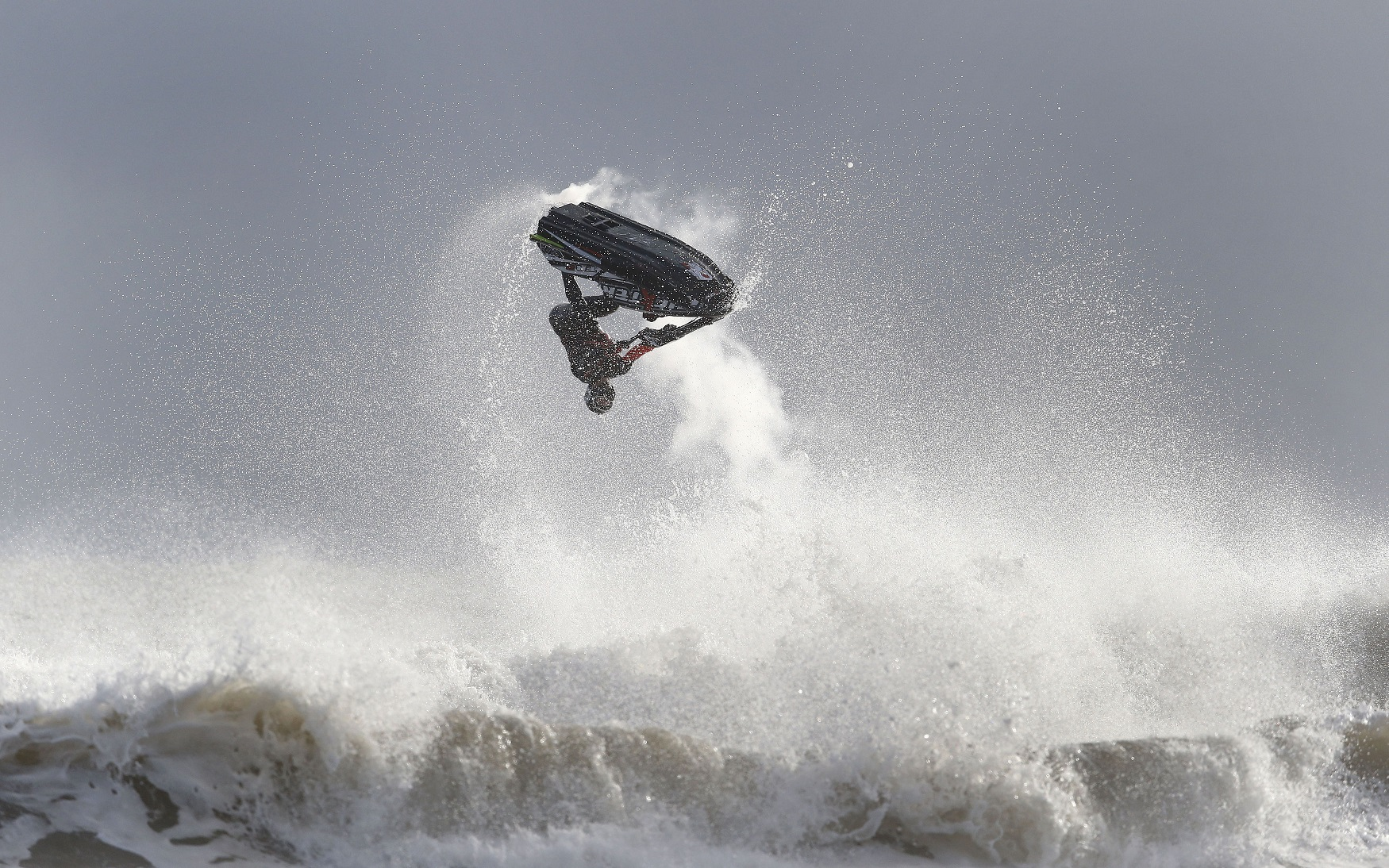 Слайд 22 из 86: A jet skier takes part in round one of the UK Battle of the Pilots jet ski championships, which took place at Blyth beach, Northumberland this weekend.