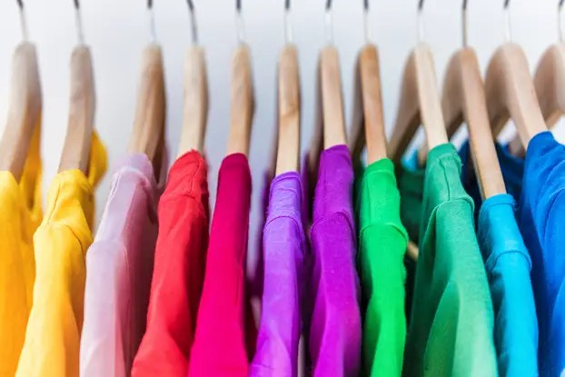 Fashion,Clothes,On,Clothing,Rack,-,Bright,Colorful,Closet.,Closeup