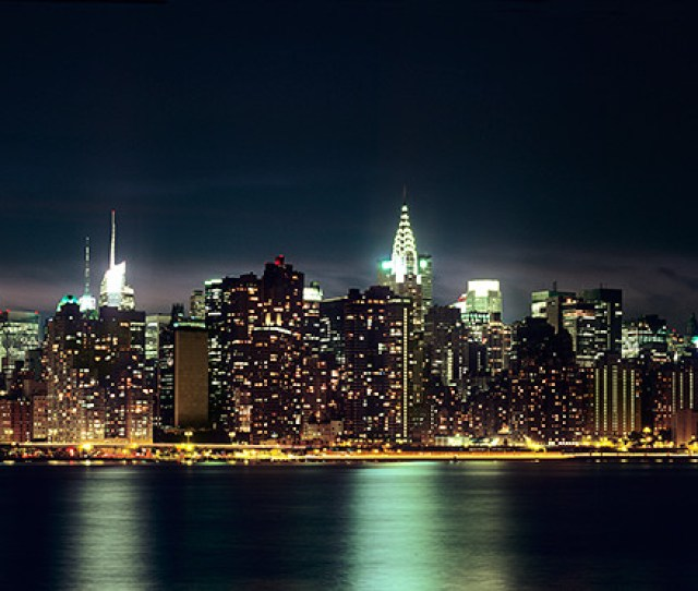 Panoramic Skyline Of New York From Brooklyn At Night