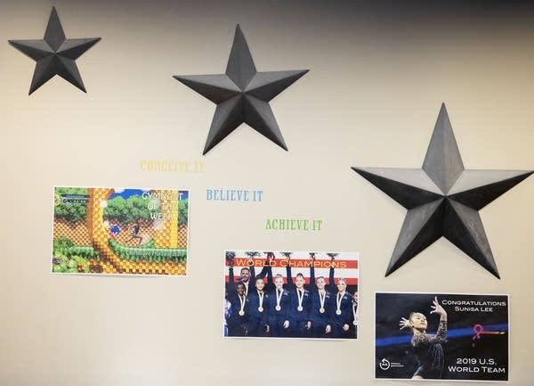 Posters and stars on a wall.