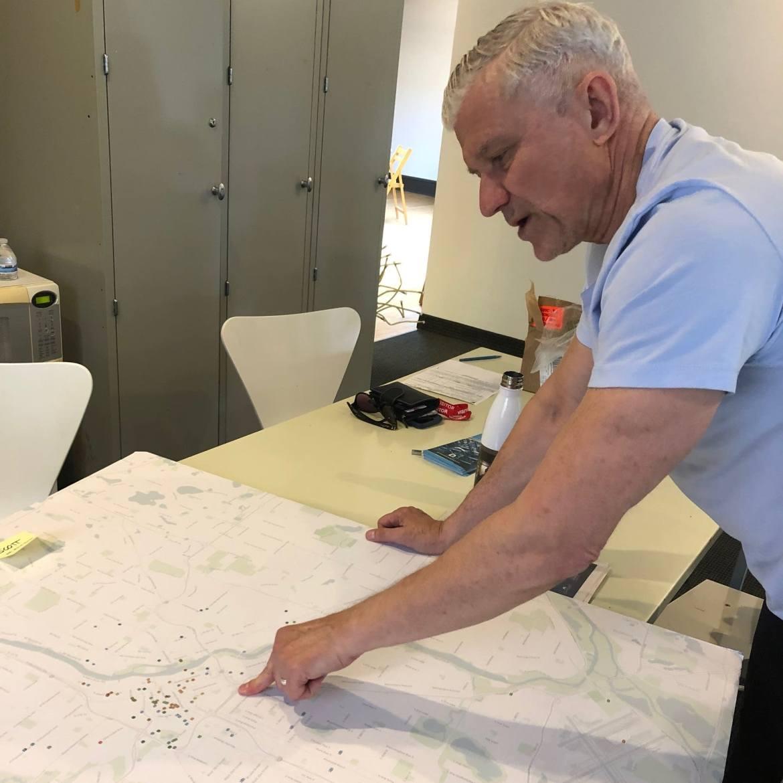 Minneapolis Open Door director, Scott Mayer, looks at a map of your building.