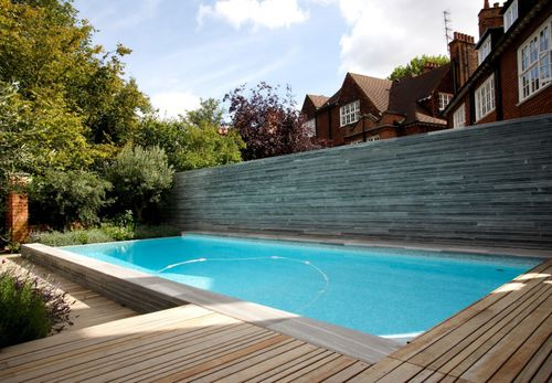 In-ground swimming pool / concrete / overflow / outdoor HAMPSTEAD GUNCAST SWIMMING POOLS