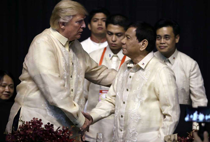 Donald Trump shakes hands with Rodrigo Duterte at the ASEAN Summit held in Manila in November 2017. REUTERS