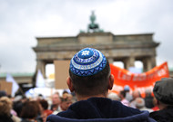 Participants in a march against anti-Semitism stand in front of the door ...