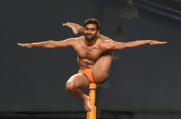 Indian gymnast practices 'yoga on pole' at Mallakhamb World Championships, a traditional Indian discipline, on 16 February 2019 in Mumbai / AFP / Archives