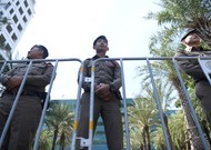 Police officers stand guard at the Constitutional Court of Bangkok, hangs ...