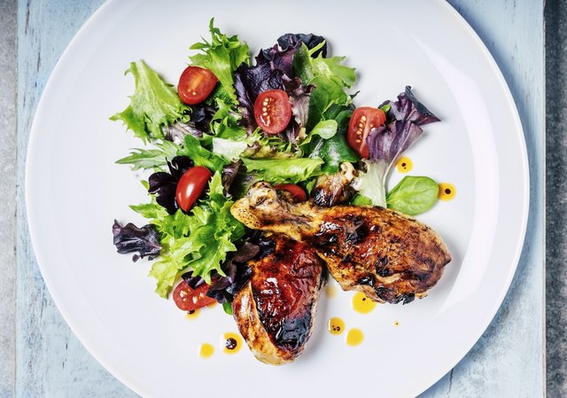 Roasted chicken and fresh salad is a healthy meal to help you get 30% of your daily calories from protein.