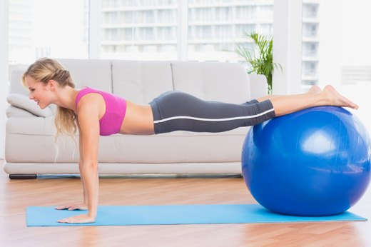 6. Replace Ab Roller With Plank Knee Tuck on a Ball
