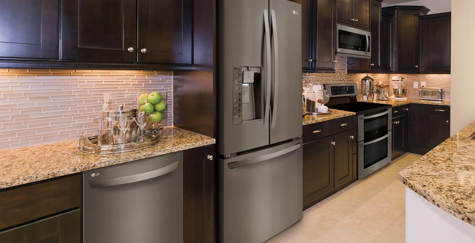 Matte Kitchen Appliances Silver Appliances in Brown Kitchen with Light Counters